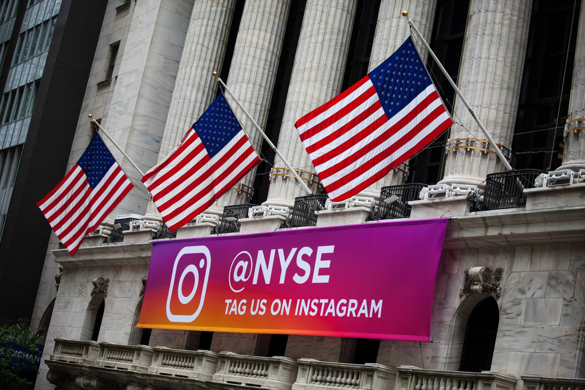 An Instagram banner hangs below American flags flying outside of the New York Stock Exchange in New York on Sept. 14, 2018.