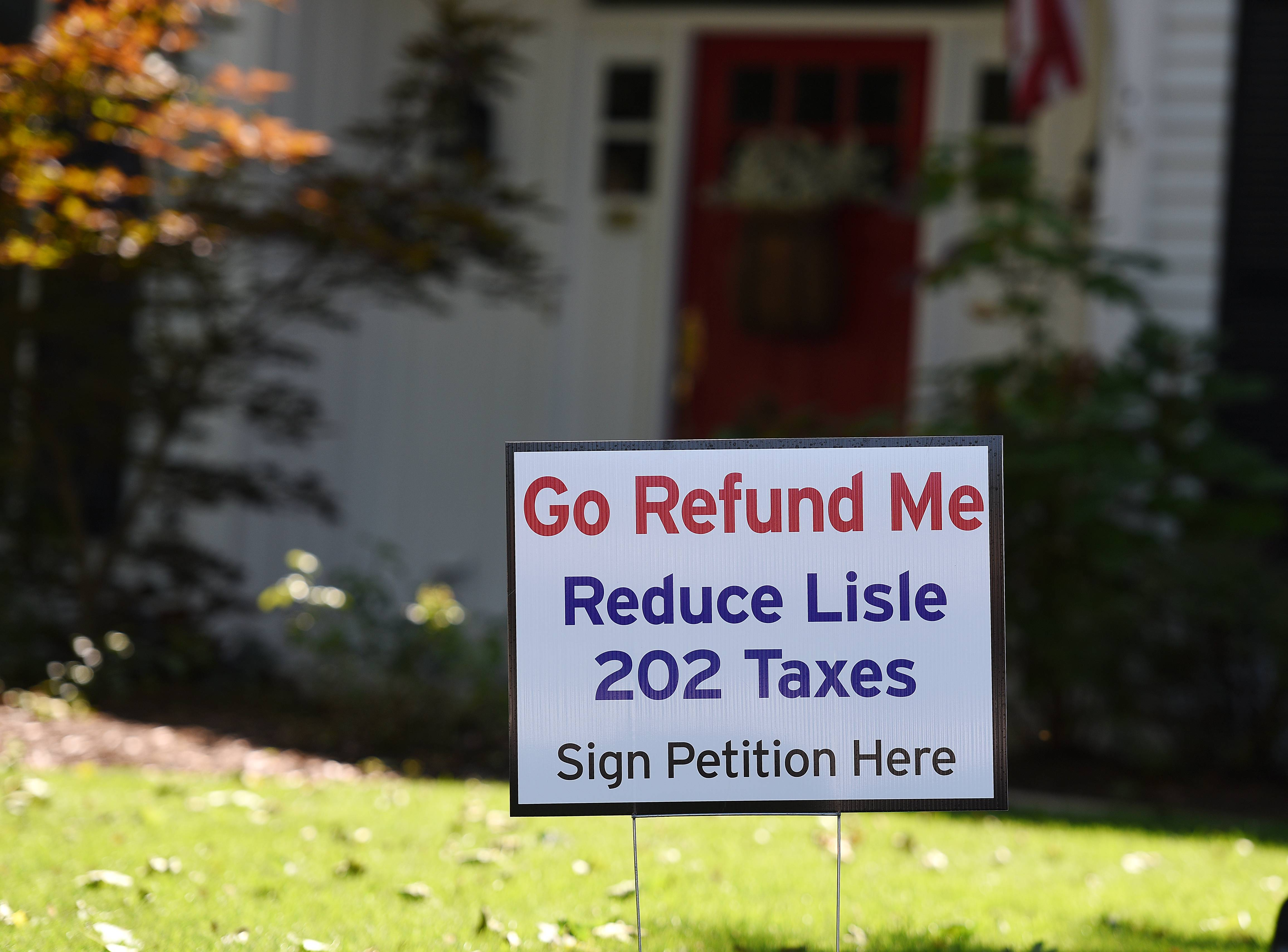 "A home in Lisle displays a ""Go Refund Me"" sign. A provision in Illinois' new school funding law could permit voter-driven ballot questions in districts whose funding levels exceed the state's base definition of 'adequate.'"