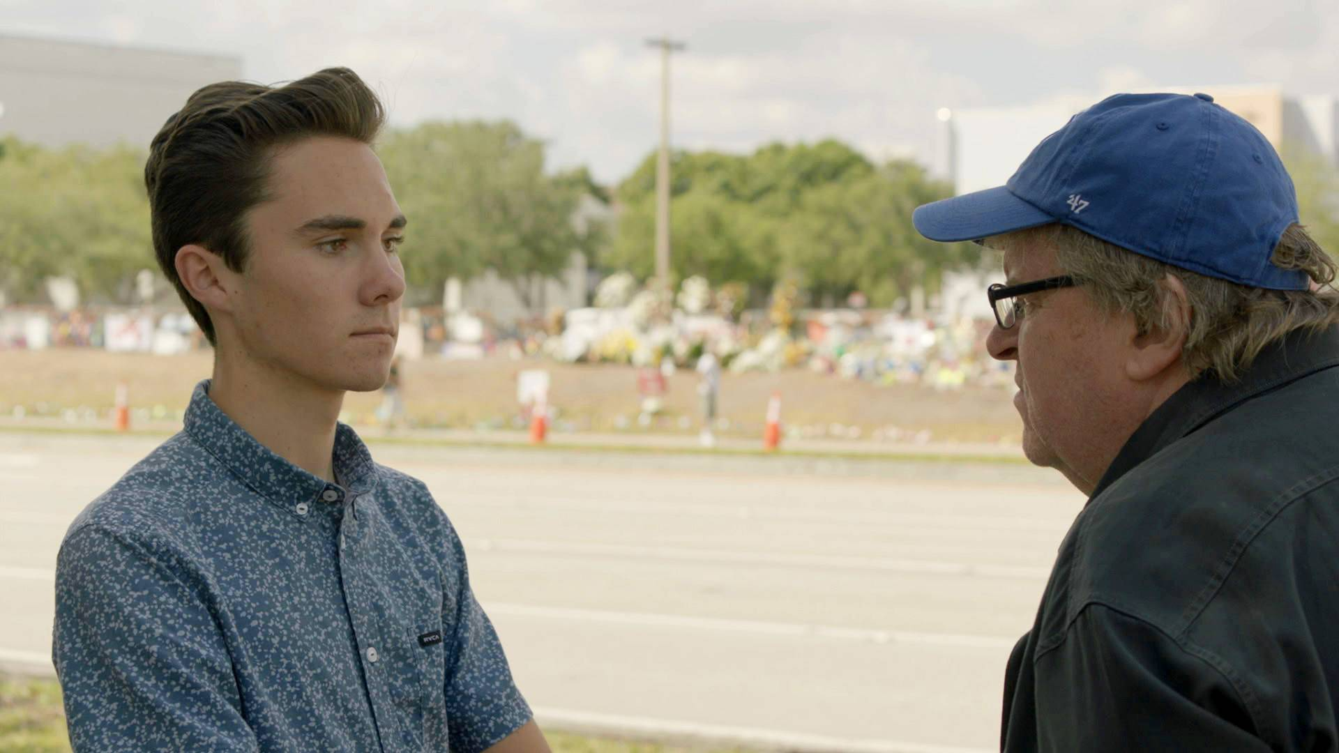 "Filmmaker Michael Moore, right, interviews David Hogg, a survivor of the Parkland school shooting and a gun-control activist, in ""Fahrenheit 11/9."""
