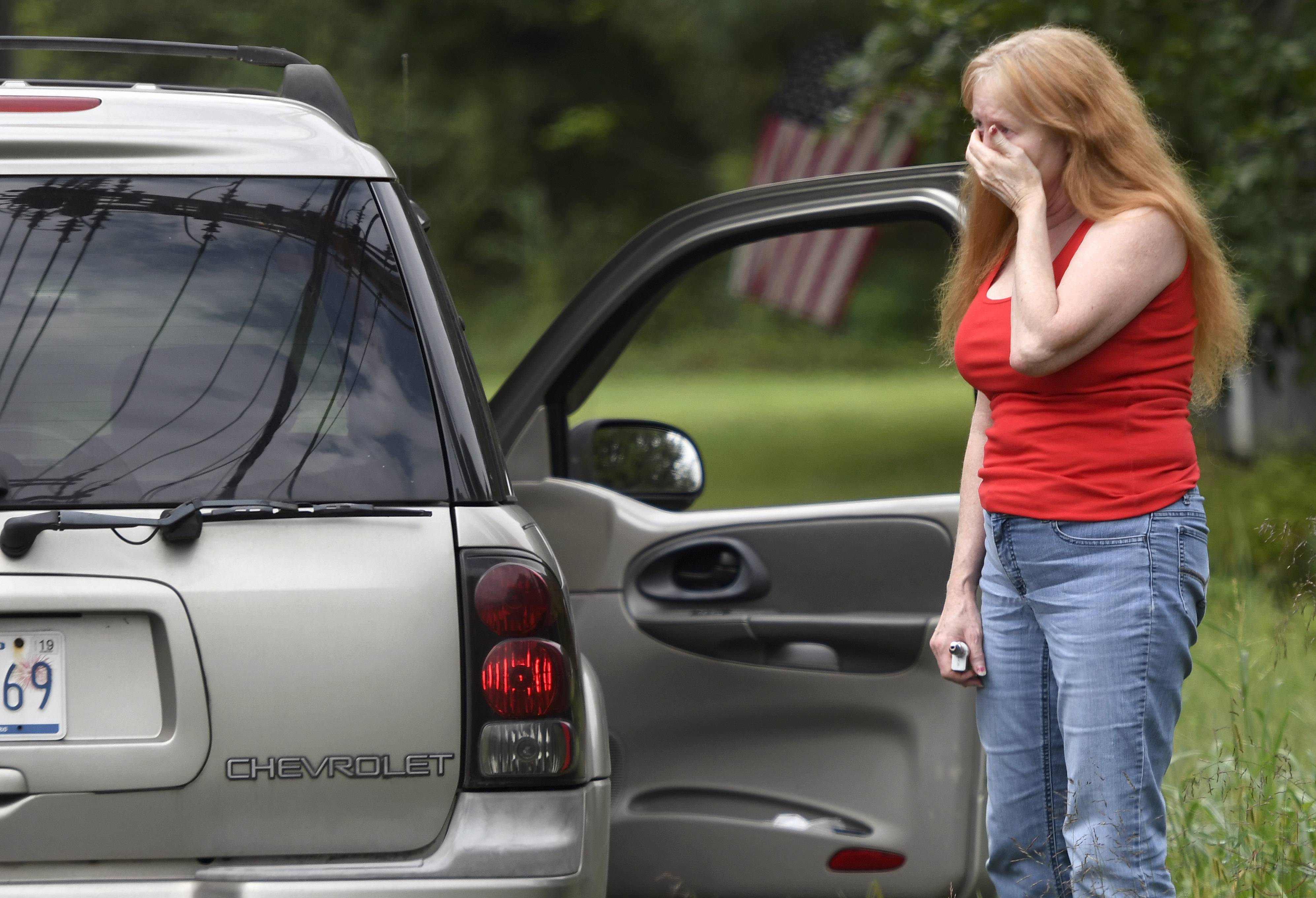Shirley Pollack, of Perryville, Md. reacts to what authorities have called a shooting with multiple victims in Perryman, Md. on Thursday, Sept. 20, 2018. Pollack was concerned about her son, who worked near the scene of the shooting. (AP Photo/Steve Ruark)