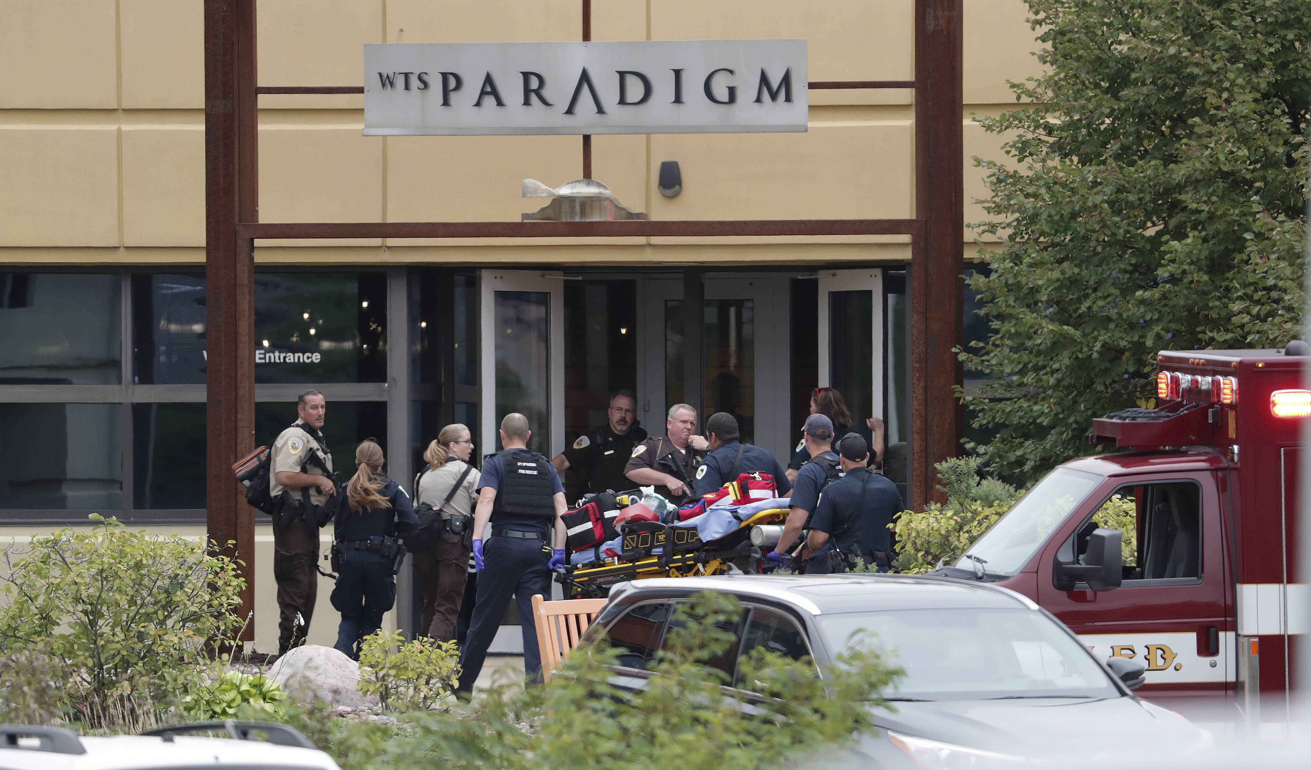 Emergency personnel arrive on the scene of a shooting at a software company in Middleton, Wis., Wednesday, Sept. 19, 2018. Four people were shot and wounded during the shooting in the suburb of Madison, according to a city administrator.