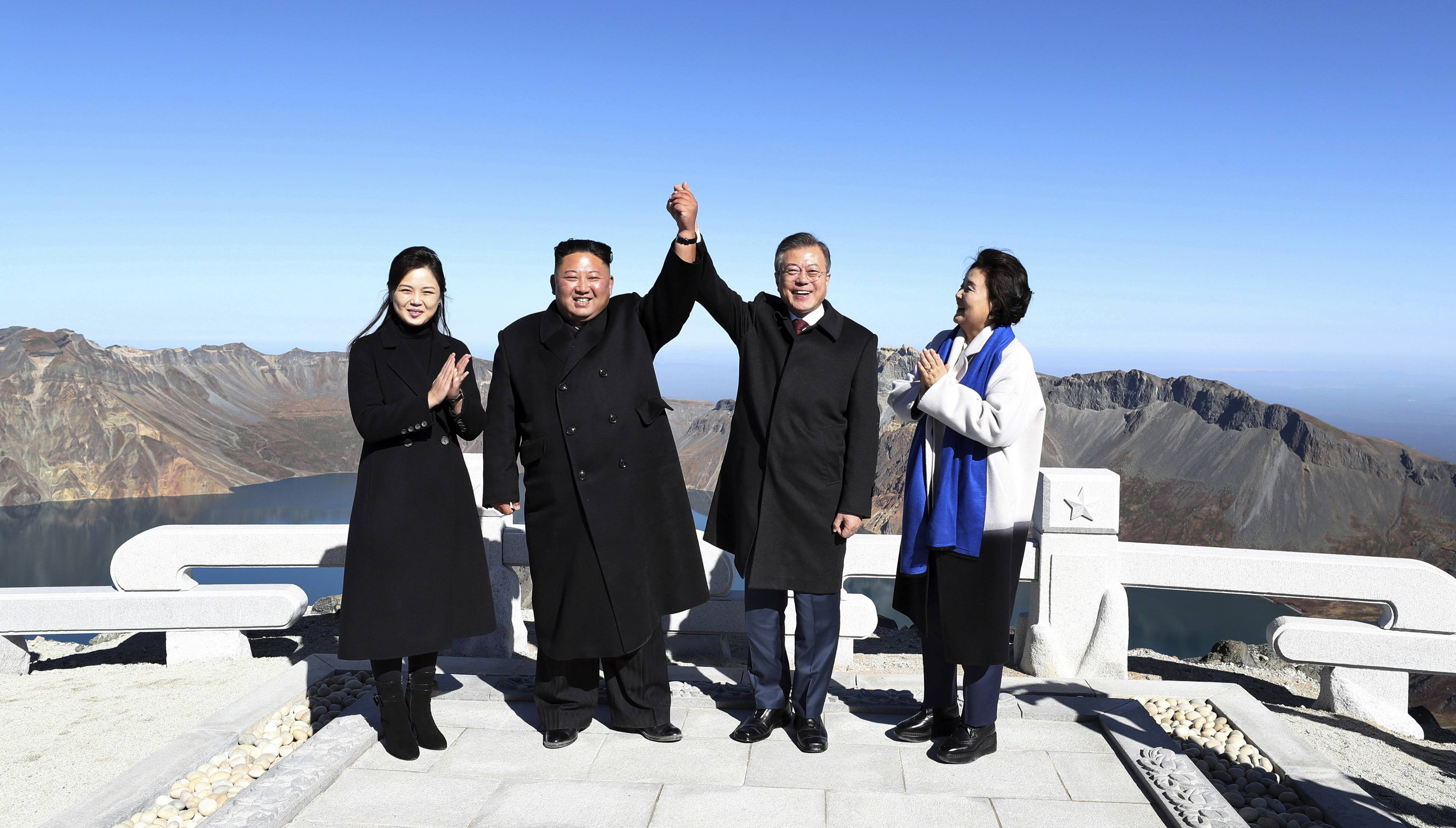 South Korean President Moon Jae-in, second from right, and his wife Kim Jung-sook, right, stand with North Korean leader Kim Jong Un, second from left, and his wife Ri Sol Ju on the Mount Paektu in North Korea, Thursday, Sept. 20, 2018.