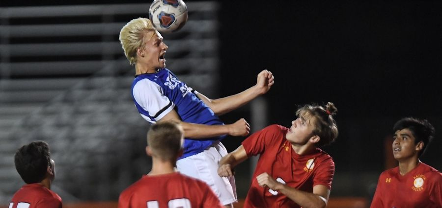 Geneva's Daniel Belzer gets above Batavia players for a header Thursday at East High School.
