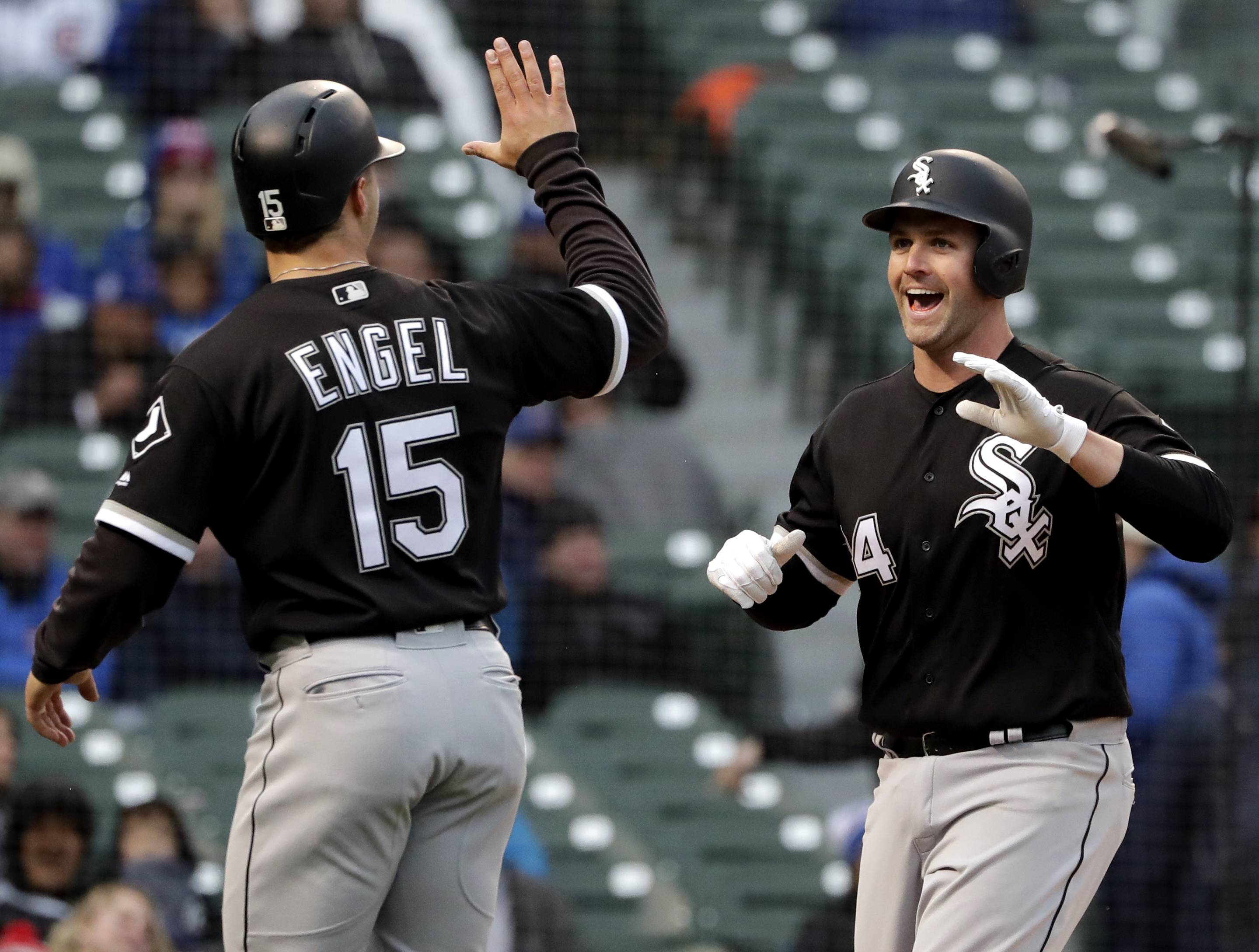 Chicago White Sox third baseman Matt Davidson, right, smiles as he celebrates with outfielder Adam Engel after hitting a 3-run homer against the Cubs during Game 2 of the 2018 Crosstown Classic. It's been another tough season for the White Sox, but they can get a jump on their promising future with a strong showing against the rival Chicago Cubs this weekend at Guaranteed Rate Field.