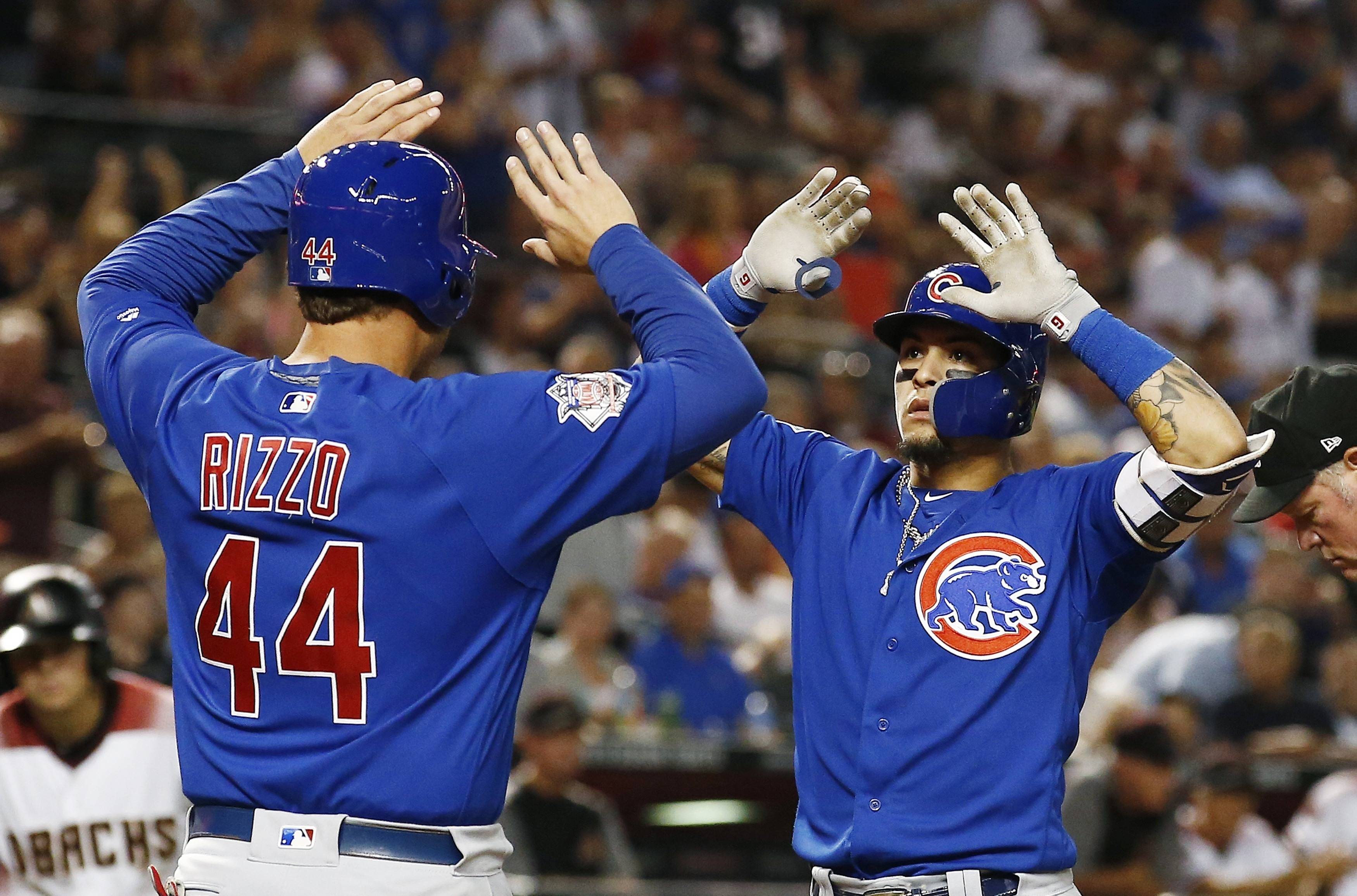 Cubs infielder Javier Baez, right, celebrates his 2-run homer against the Arizona Diamondbacks with first baseman Anthony Rizzo (44) during Monday's win over the Diamondbacks. Thirty days in the desert for the Cubs? Not quite, but on Thursday, they enjoyed their first real off-day in the schedule since Aug. 20. In between was an action-packed 30 days, setting them up for the final push.