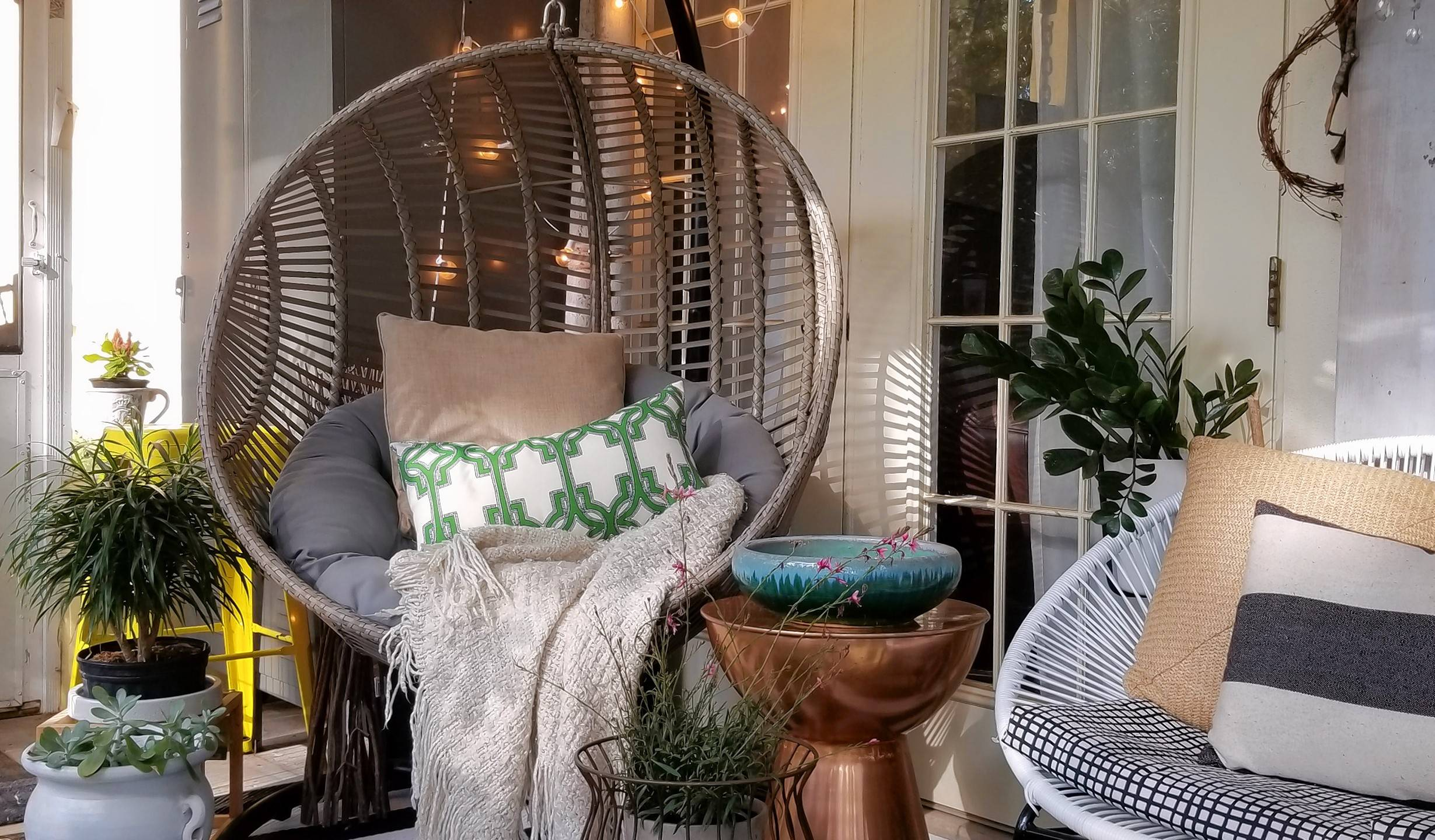 Blogger, decorator and product stylist Holli Rodrigues decorated her patio with a hanging egg chair and shared it on her blog, Bees N' Burlap.