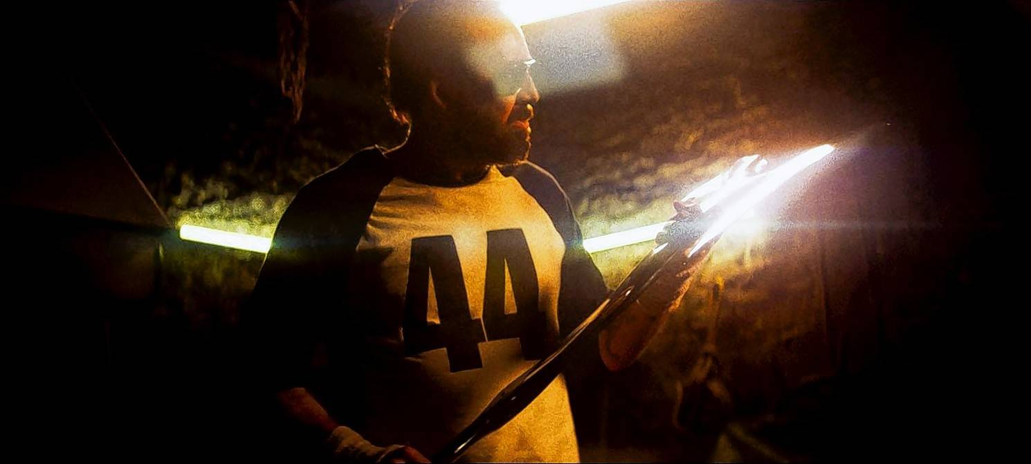 "Red Miller (Nicolas Cage) fashions a heavy metal ax for some nighttime ... hunting, yeah, hunting ... in ""Mandy."""