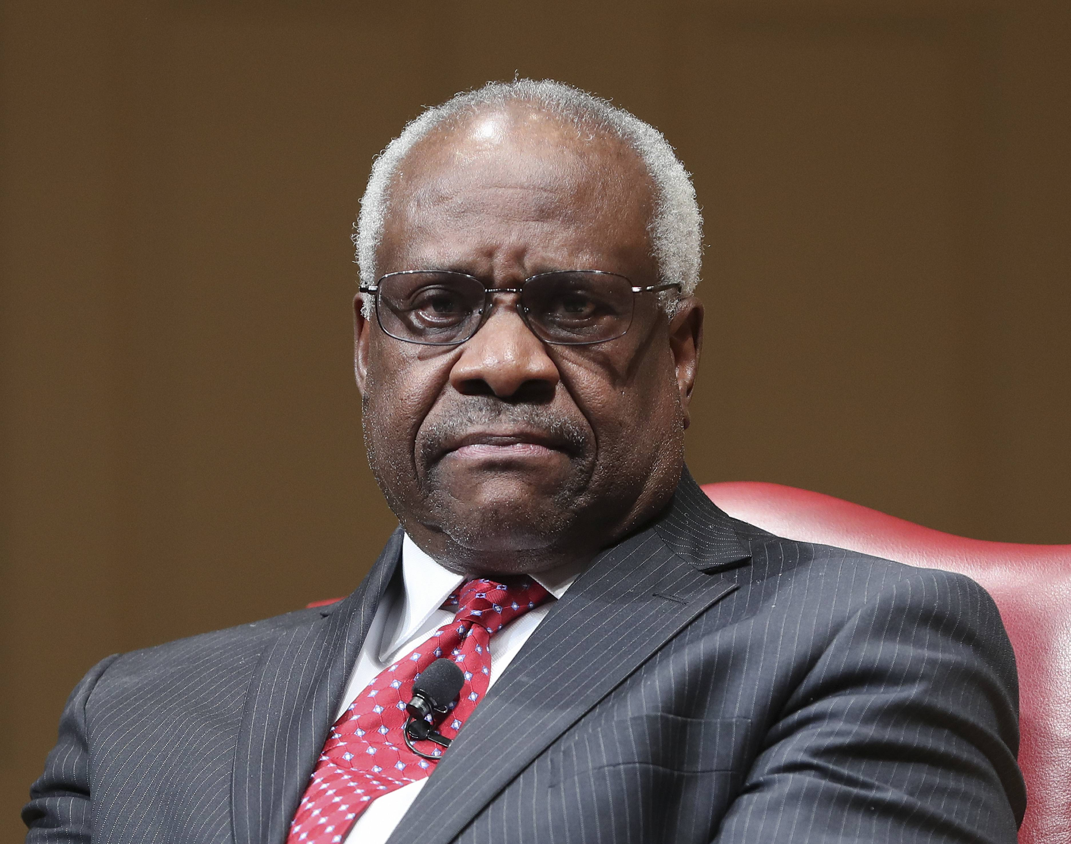 "FILE — In this Feb. 15, 2018, file photo, Supreme Court Associate Justice Clarence Thomas sits as he is introduced during an event at the Library of Congress in Washington. When Thomas arrived at the Supreme Court in the fall of 1991 after a bruising confirmation hearing in which his former employee Anita Hill accused him of sexual harassment, fellow justice Byron White said something that stuck with him. ""It doesn't matter how you got here. All that matters now is what you do here,"" Thomas recounted in his 2007 memoir, ""My Grandfather's Son."""