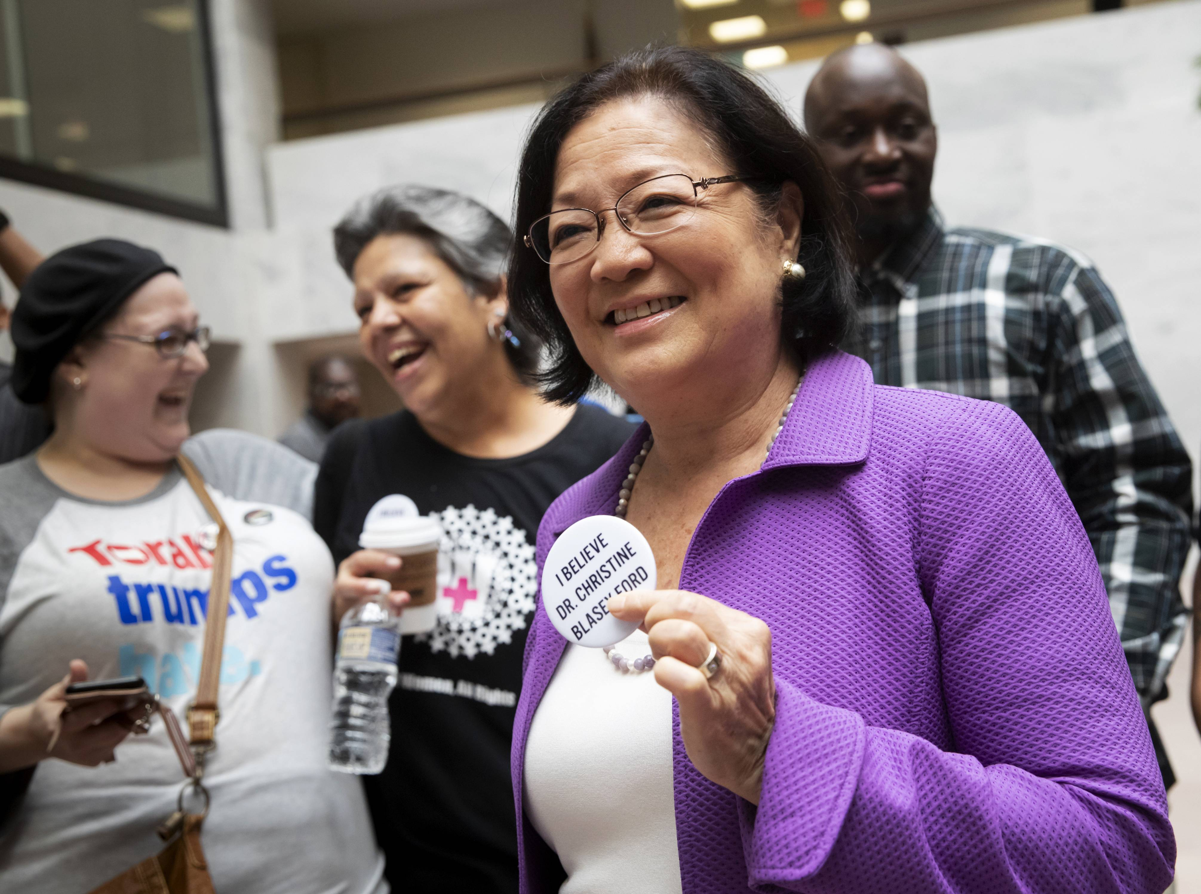 Sen. Mazie Hirono, D-Hawaii, a member of the Senate Judiciary Committee, is welcomed by protesters opposed to President Donald Trump's Supreme Court nominee, Brett Kavanaugh, as they demonstrate in the Hart Senate Office Building on Capitol Hill in Washington, Thursday, Sept. 20, 2018. Kavanaugh has denied stories of a sexual assault as alleged by California college professor Christine Blasey Ford.
