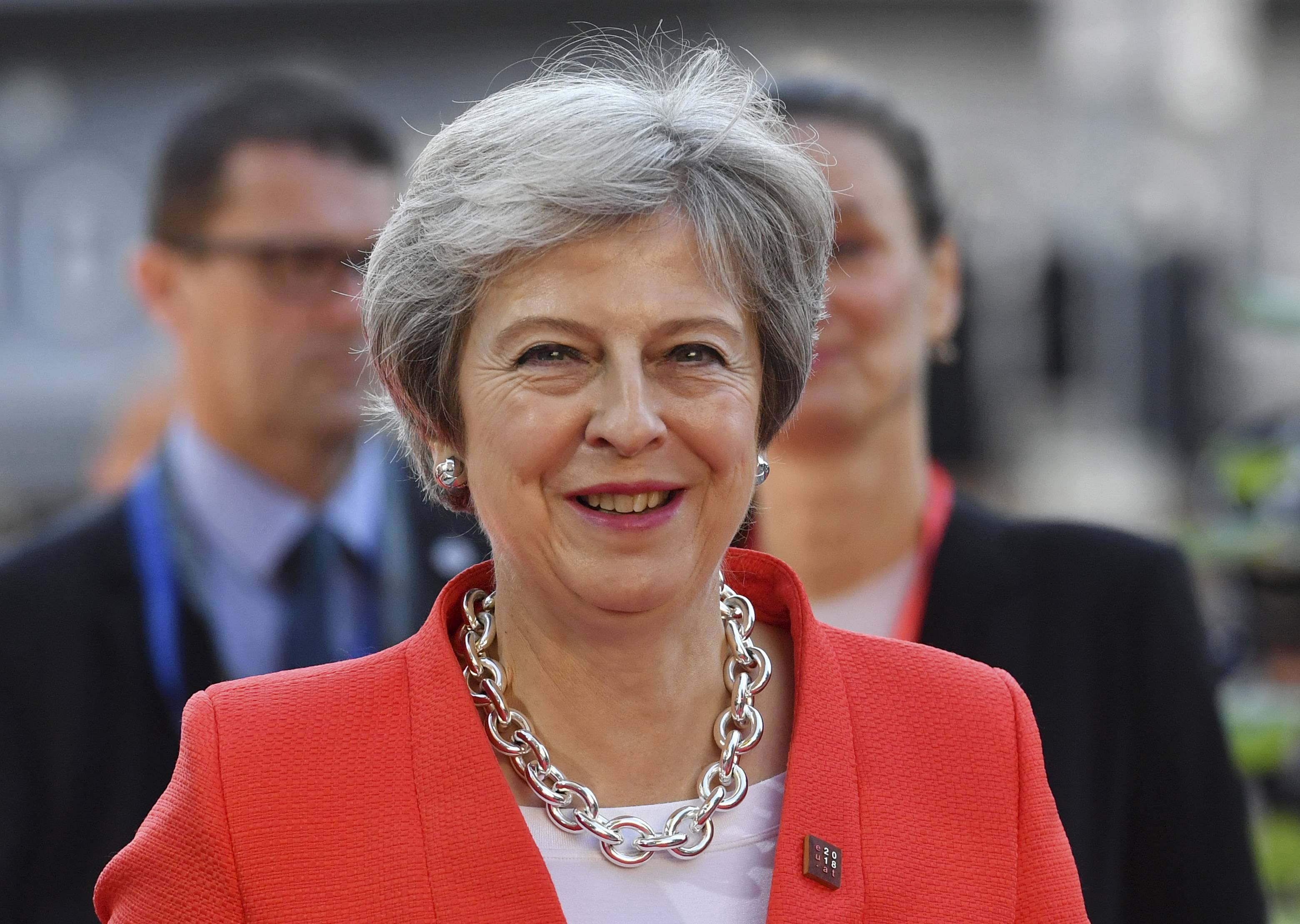 British Prime Minister Theresa May smiles when arriving at the informal EU summit in Salzburg, Austria, Thursday, Sept. 20, 2018.