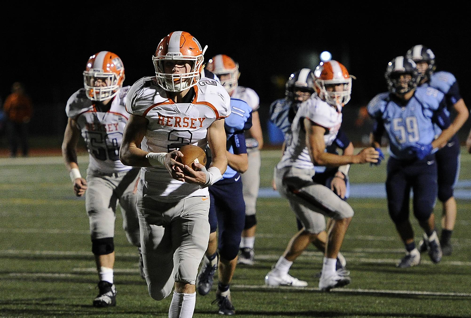 Hersey's Jordan Hansen makes a 22-yard first quarter touchdown run.