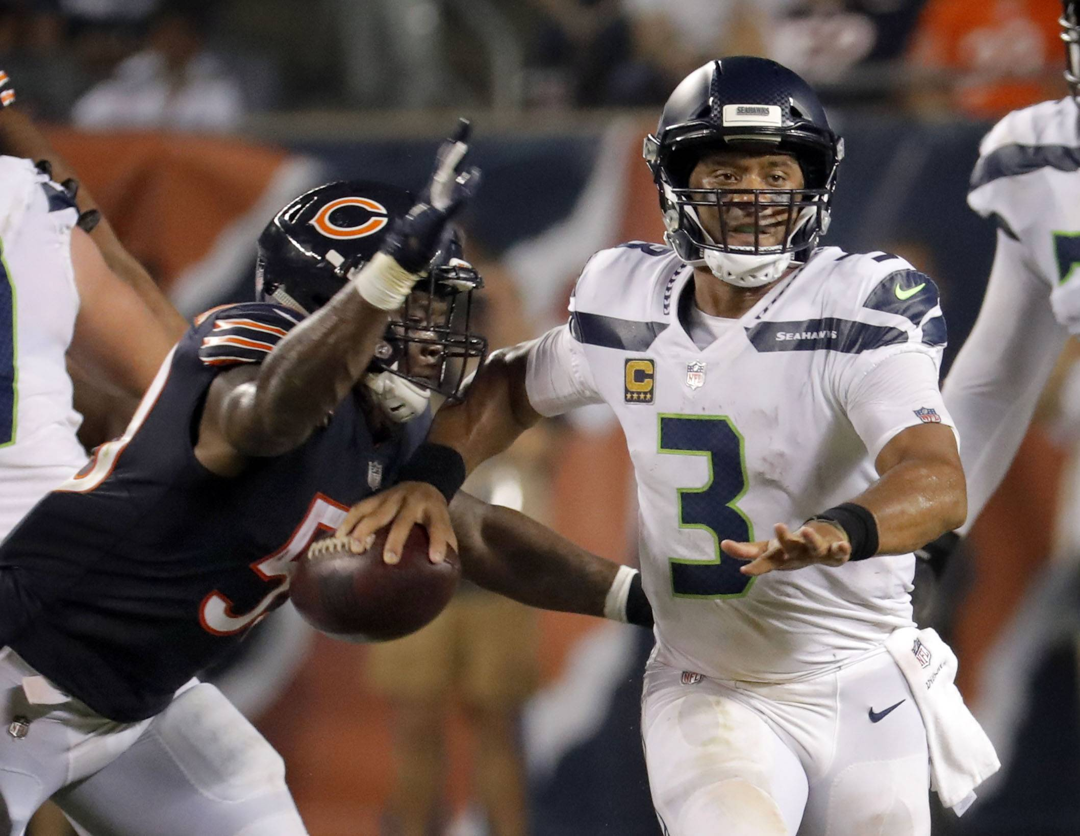 Bears linebacker Danny Trevathan strip sacks Seattle Seahawks quarterback Russell Wilson during the Chicago Bears vs the Seattle Seahawks game Monday September 17, 2018 at Soldier Field in Chicago. The seven-year veteran had the first multiple-sack game of his career vs. the Seahawks, forced a fumble on one of them, which outside linebacker Leonard Floyd recovered, and had 8 tackles. Trevathan leads the Bears this season with 15 total tackles and 11 solos.