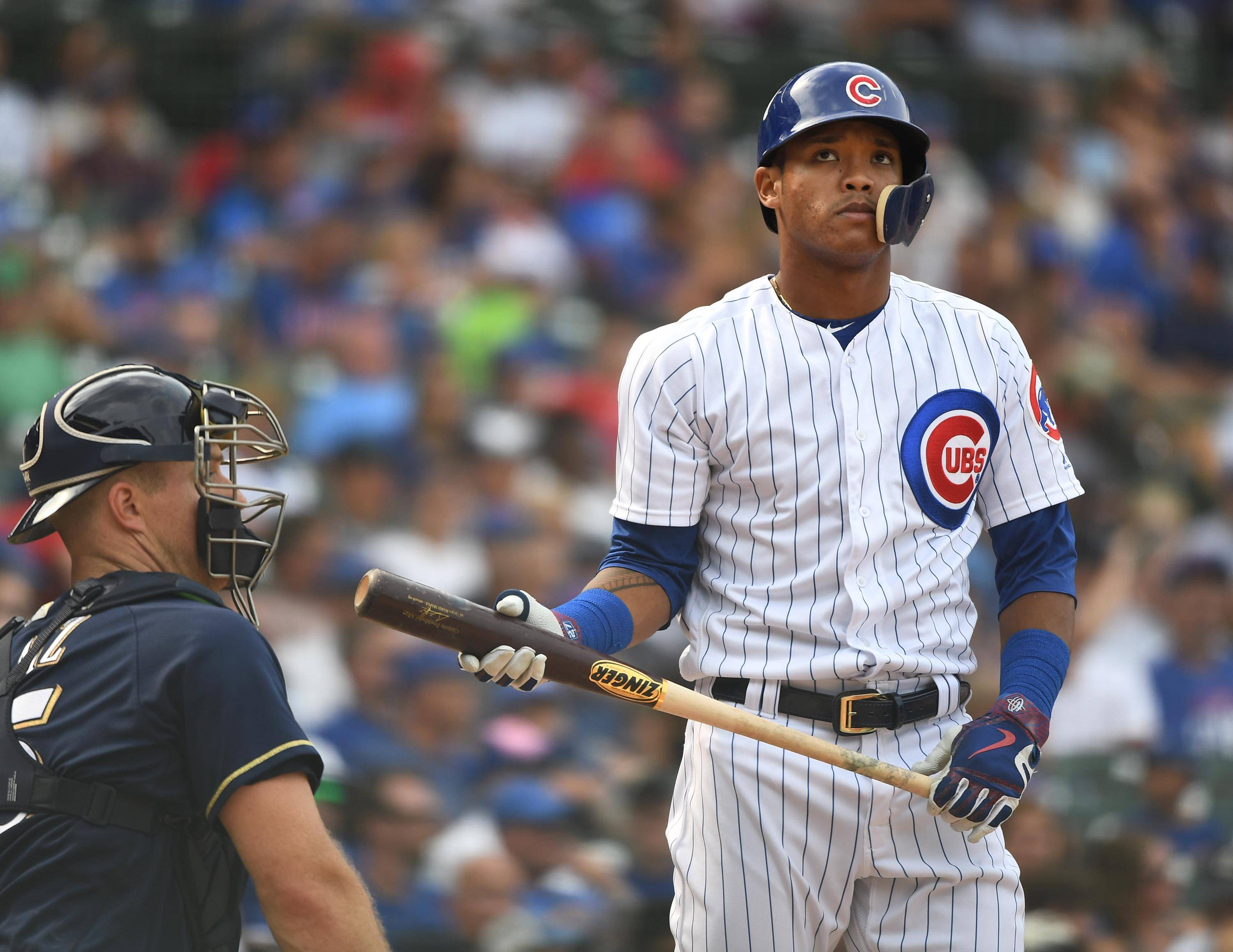 Major League Baseball has placed Cubs shortstop Addison Russell on administrative leave, the team said Friday. His ex-wife has accused him of emotional, verbal and physical abuse.