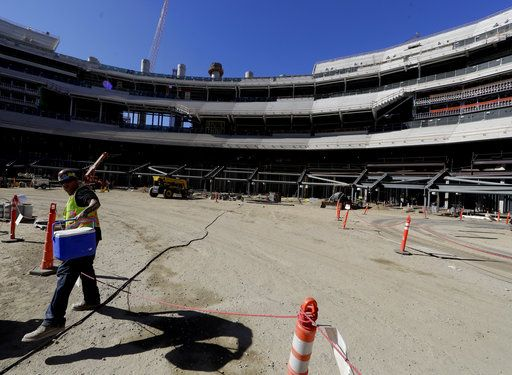A construction worker works in the bowl of the new LA Stadium on Tuesday, Sept. 18, 2018, in Inglewood, Calif. The new facility for the Los Angeles Rams, and Los Angeles Chargers is tentatively scheduled to be competed for the 2020 NFL football season.