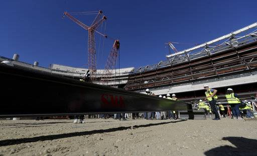 Visitors tour the LA Stadium construction site on Tuesday, Sept. 18, 2018, in Inglewood, Calif. The new facility for the Los Angeles Rams and Los Angeles Chargers is tentatively scheduled to be competed for the 2020 NFL football season.