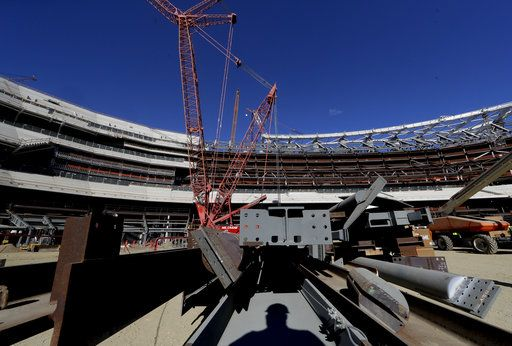 A large crane looms over LA Stadium on Tuesday, Sept. 18, 2018, in Inglewood, Calif. The new facility for the Los Angeles Rams, and  Los Angeles Chargers is tentatively scheduled to be competed for the 2020 NFL football season.