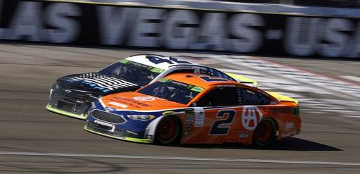 Brad Keselowski (2) and Kyle Larson pass the start/finish line during a NASCAR Cup Series auto race Sunday, Sept. 16, 2018, in Las Vegas. (AP Photo/Isaac Brekken)