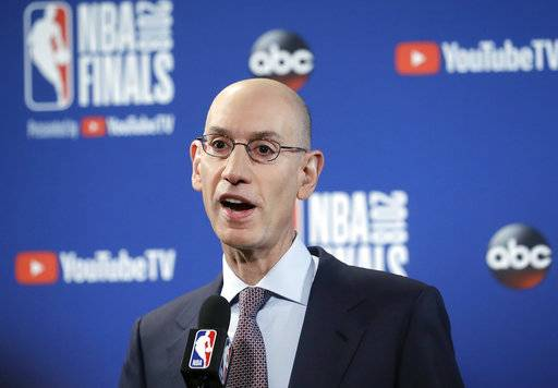 FILE - In this May 31, 2018, file photo, NBA Commissioner Adam Silver speaks at a news conference before Game 1 of basketball's NBA Finals between the Golden State Warriors and the Cleveland Cavaliers in Oakland, Calif. Silver wants all teams to hire more women, especially in leadership and supervisory positions, and is urging them to take some of the mandates that the Dallas Mavericks must now adhere to as an impetus to improve working conditions within their own organizations, according to a memo sent to all teams Friday, Sept. 21, 2018, and obtained by The Associated Press