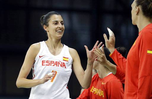 FILE - In this Aug. 14, 2016, file photo, Spain forward Alba Torrens is greeted at the bench during the second half of a women's basketball game against Canada at the Youth Center at the 2016 Summer Olympics in Rio de Janeiro, Brazil. Arguably the best player in Europe, Torrens has been part of the Spanish national team since 2008. (AP Photo/Carlos Osorio, File)