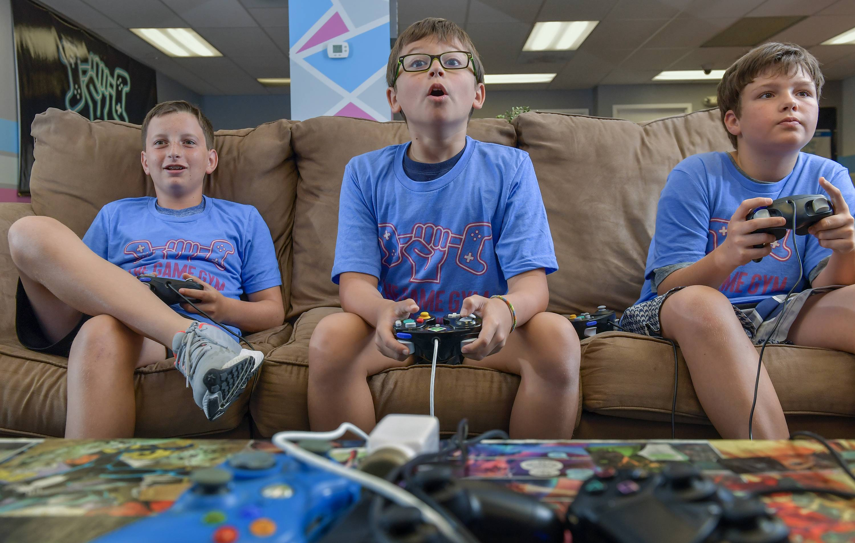 Aiden Keneally, Roman Wright and Benny O'Neill enjoy a game of Super Smash Brothers at a Game Gym camp in Potomac, Md., in late August.