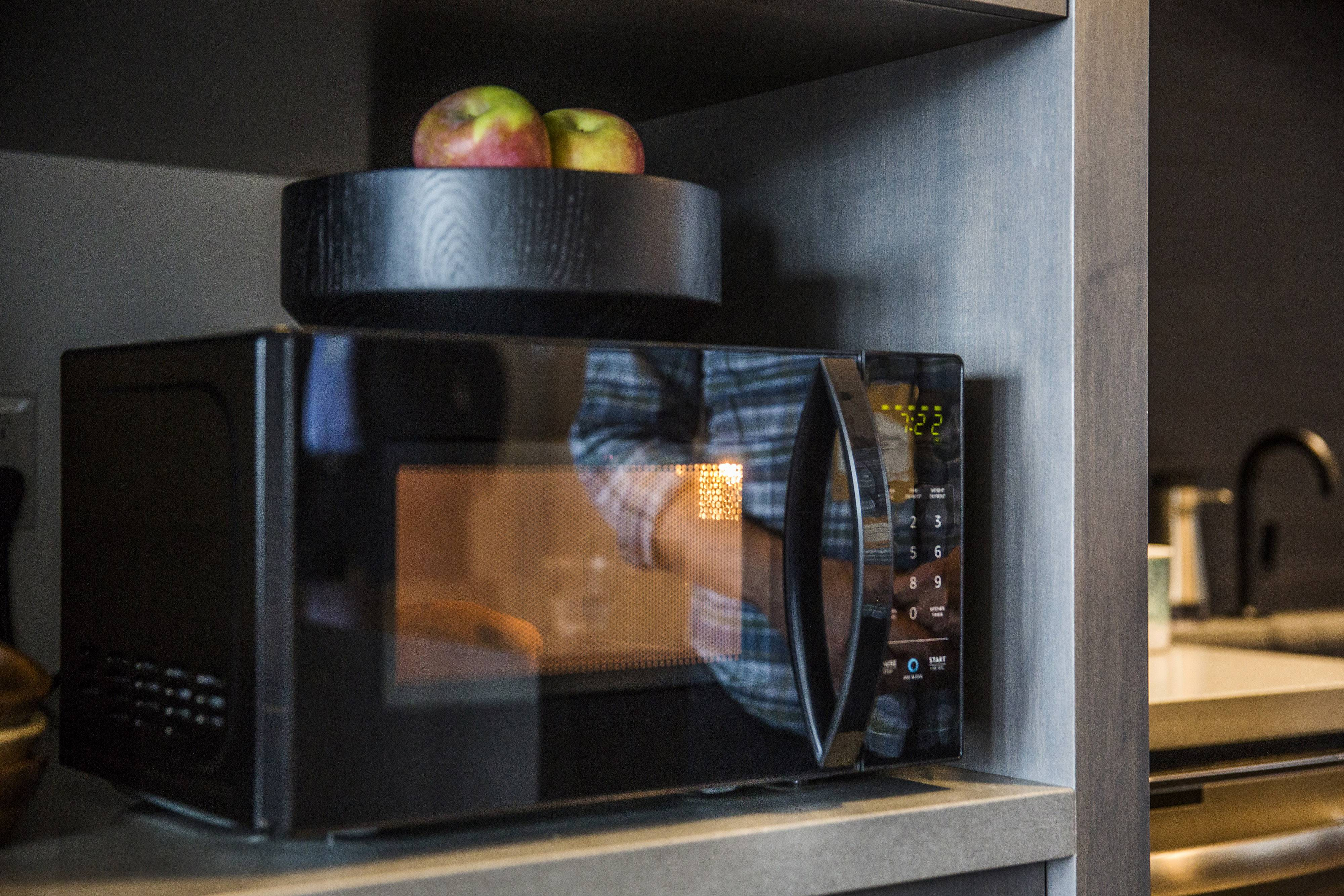 An AmazonBasics Microwave sits on display during an unveiling event at the Amazon.com Spheres headquarters in Seattle on Thursday.