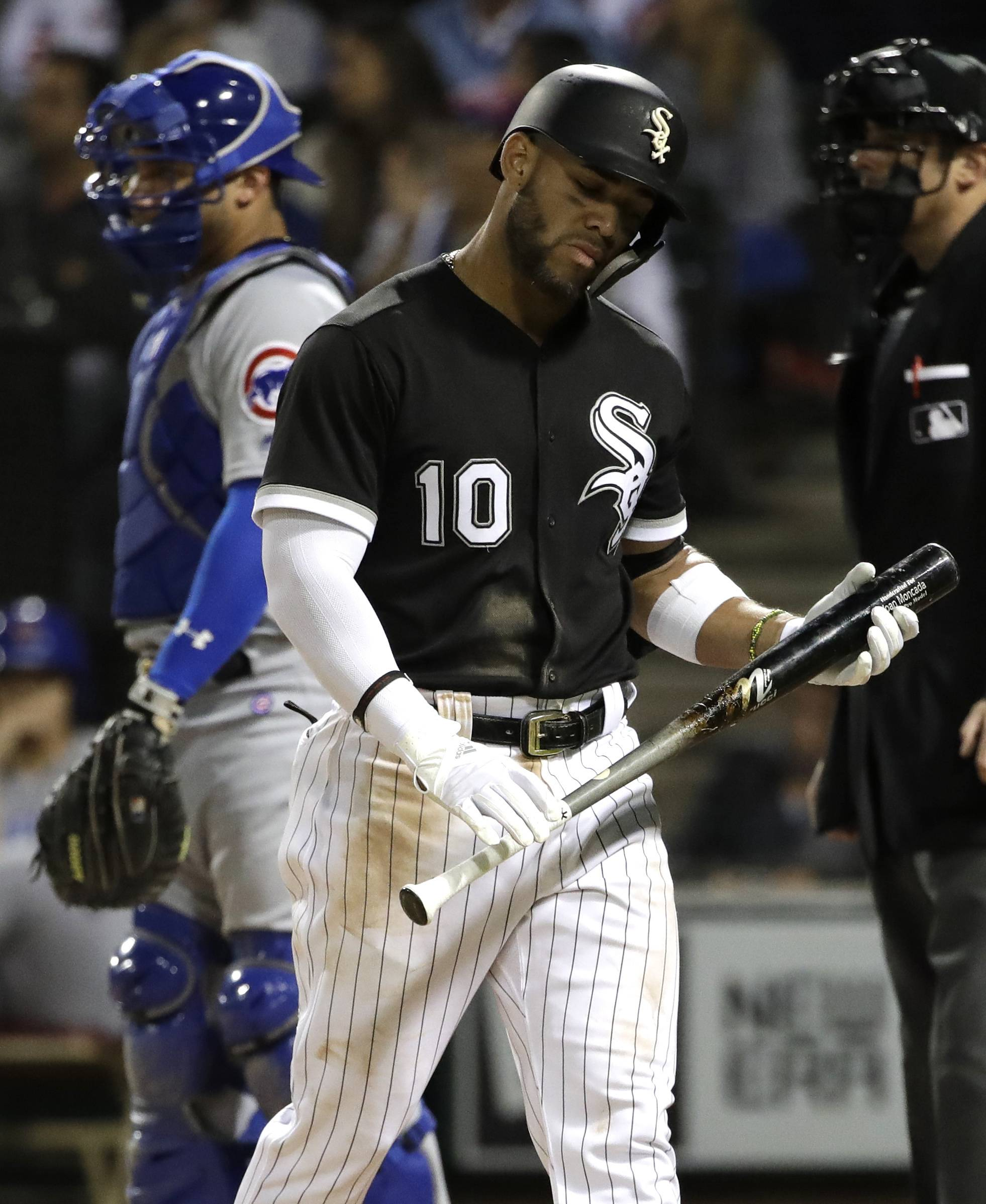 Chicago White Sox's Yoan Moncada reacts after being called out on strikes during the fourth inning of a baseball game against the Chicago Cubs, Saturday, Sept. 22, 2018, in Chicago. (AP Photo/Nam Y. Huh)