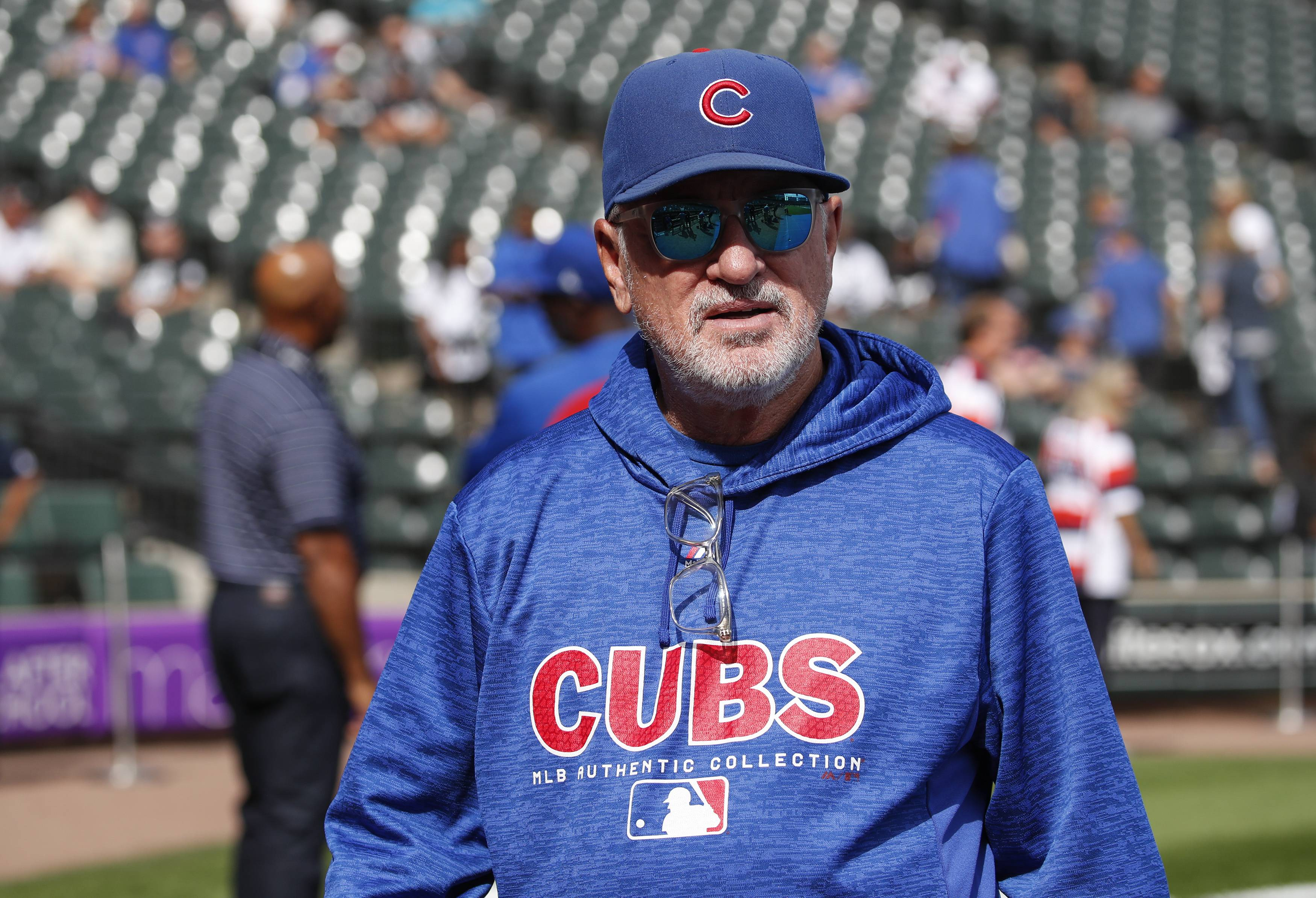 Chicago Cubs manager Joe Maddon walks on the field before a baseball game against the Chicago White Sox, Friday, Sept. 21, 2018, in Chicago.