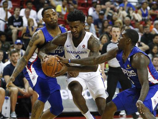 FILE - In this July 6, 2018 file photo, Golden State Warriors' Jordan Bell, center, drives between Los Angeles Clippers' Sindarius Thornwell, left, and Jawun Evans during the first half of an NBA summer league basketball game in Las Vegas. Bell had pushed his body to the brink, to exhaustion one mid-August day with far from enough food and fuel. He did Soul Cycle, weights and conditioning, then a couple hours of open gym in Los Angeles, his regular routine all summer to get ready for his second season with the NBA champion Warriors.. (AP Photo/John Locher, File)