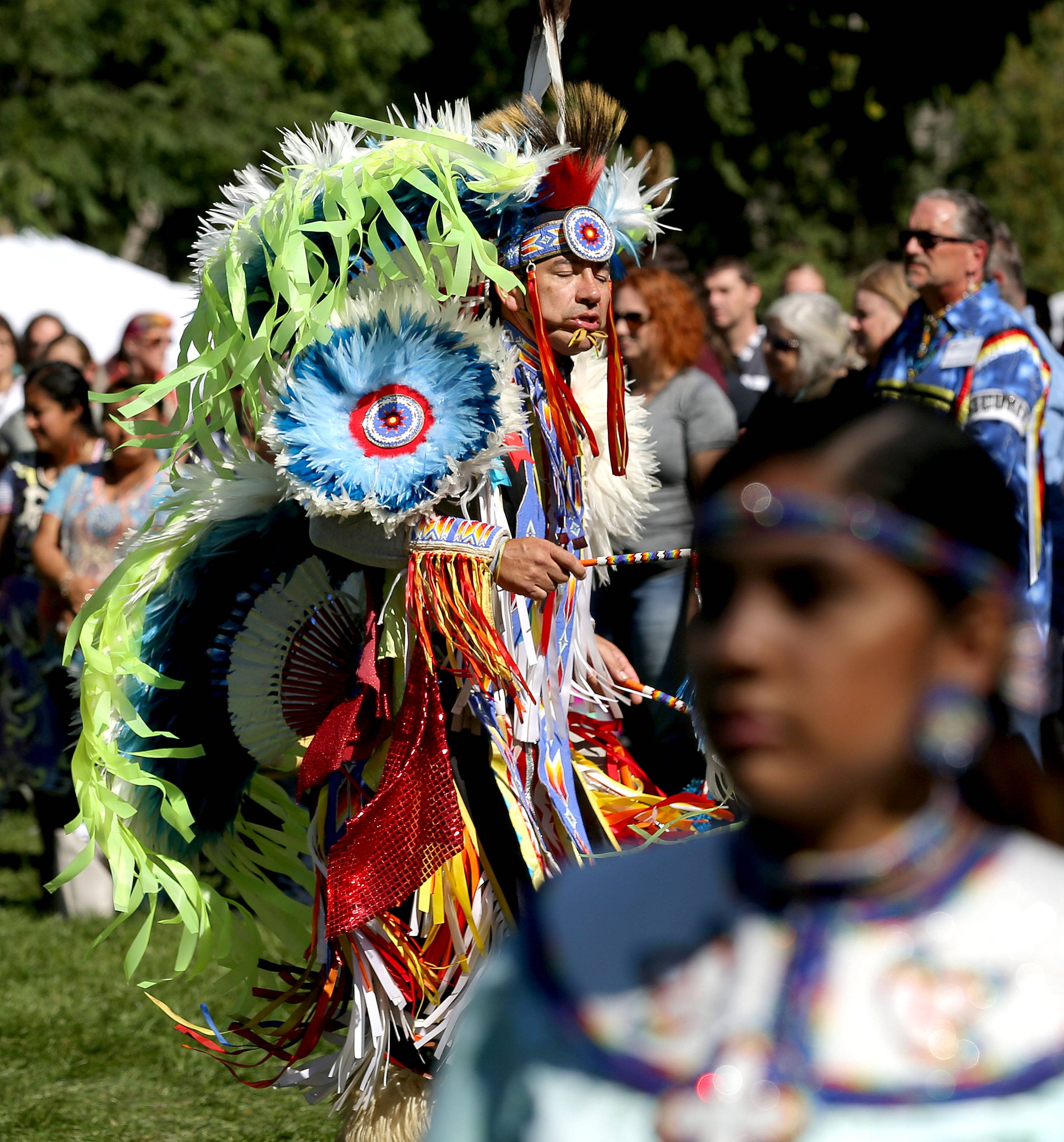 Thorpe Sine of the Ho-Chunk tribe dances in the grand entry Sunday during the 24th annual Native American Harvest Pow Wow at Naper Settlement in Naperville.