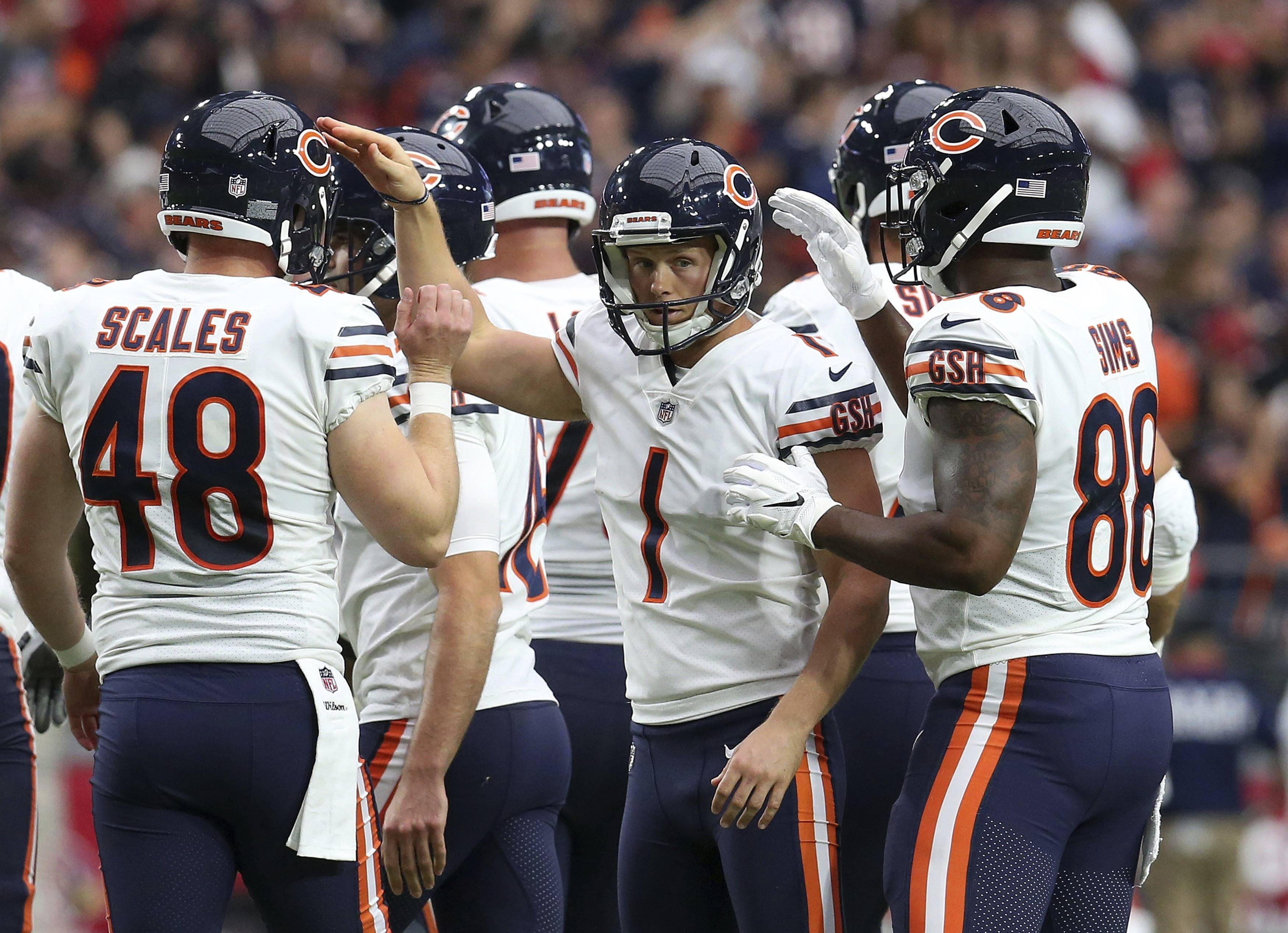 Chicago Bears kicker Cody Parkey (1) celebrates his field goal against the Arizona Cardinals with Patrick Scales (48) and Dion Sims (88) during the second half of an NFL football game, Sunday, Sept. 23, 2018, in Glendale, Ariz.