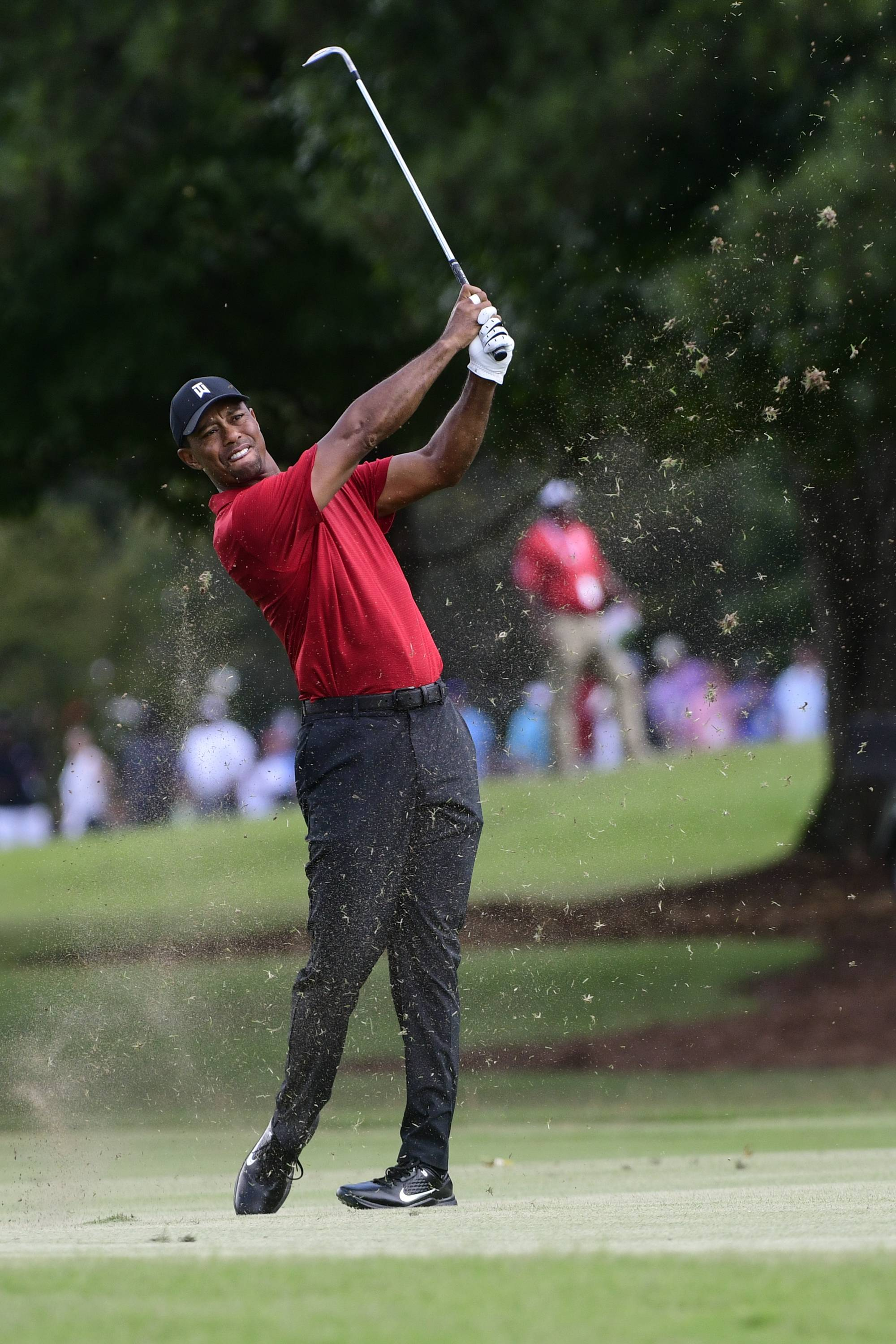 Tiger Woods hits from the third fairway during the final round of the Tour Championship golf tournament Sunday, Sept. 23, 2018, in Atlanta.