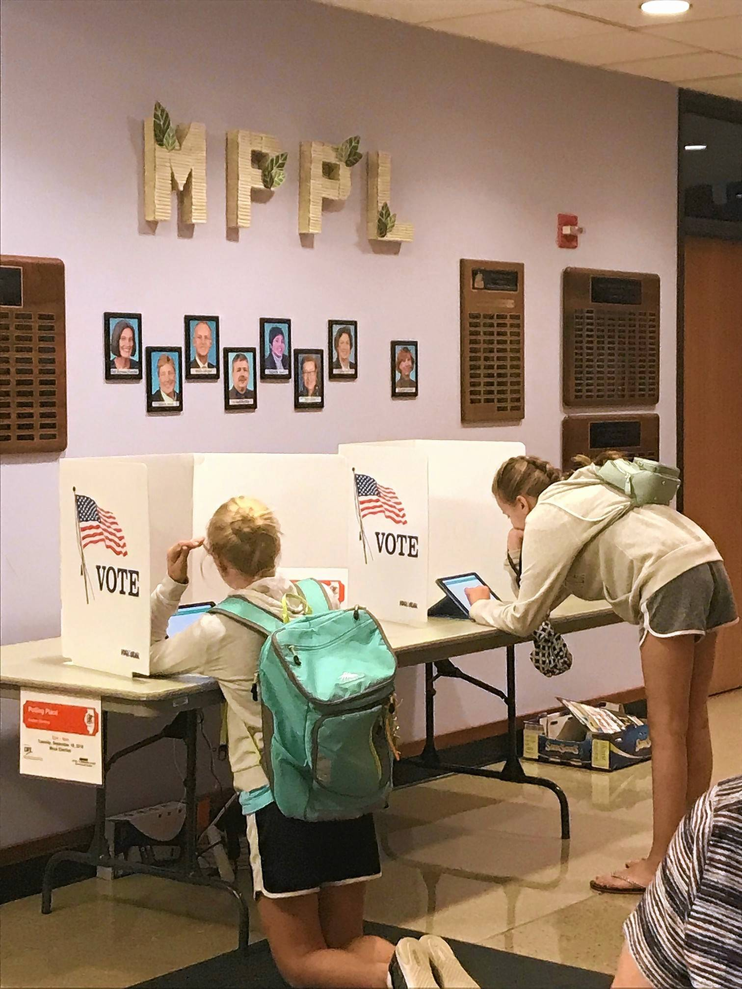 Teens voting at the Mount Prospect Public Library during a mock election event that the League of Women Voters Arlington Heights-Mount Prospect-Buffalo Grove hosted.Stacey Tobin