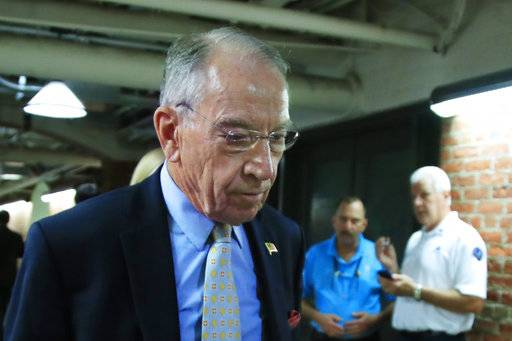 Senate Judiciary Committee Chairman Sen. Chuck Grassley, R-Iowa, walks through a tunnel towards the Dirksen Senate Building on Capitol Hill in Washington, Wednesday, Sept. 19, 2018.