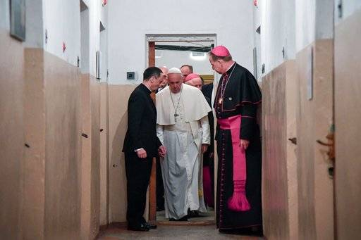 Pope Francis stops for a moment of prayer during his visit to the Museum of Occupations and Freedom Fights, in Vilnius, Lithuania, Saturday, Sept. 22, 2018. Francis began his second day in the Baltics in Lithuania's second city, Kaunas, where an estimated 3,000 Jews survived out of a community of 37,000 during the 1941-1944 Nazi occupation. (AP Photo/Andrew Medichini)