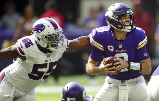 Buffalo Bills defensive end Jerry Hughes (55) pressures Minnesota Vikings quarterback Kirk Cousins (8) during the first half of an NFL football game, Sunday, Sept. 23, 2018, in Minneapolis. (AP Photo/Jim Mone)