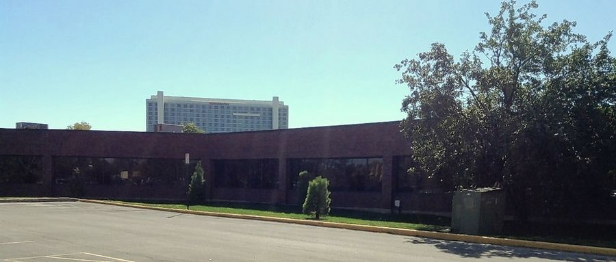 Schaumburg officials have purchased both the one-story office buildings of the Woodfield Green Executive Center and the site previously occupied by Ron Santo's American Rotisserie north of the village's convention center and Renaissance Hotel for a new entertainment district and to reconfigure Thoreau Drive.