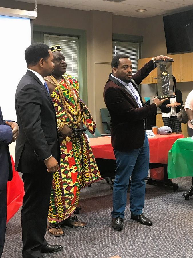 Aurora Mayor Richard Irvin, left, King Aklasou Mawuko Kwami Adelan of the canton of Bé in the West African nation of Togo, and Arnaud Adjovi, a member of the Togolese delegation, meet during a ceremony Monday at Aurora City Hall.