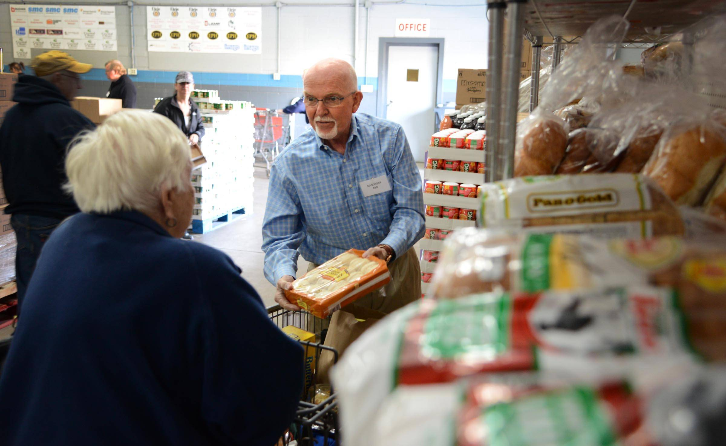 The Centre of Elgin might be renamed after former Elgin Mayor Ed Schock, pictured here volunteering at Food for Greater Elgin in 2015.