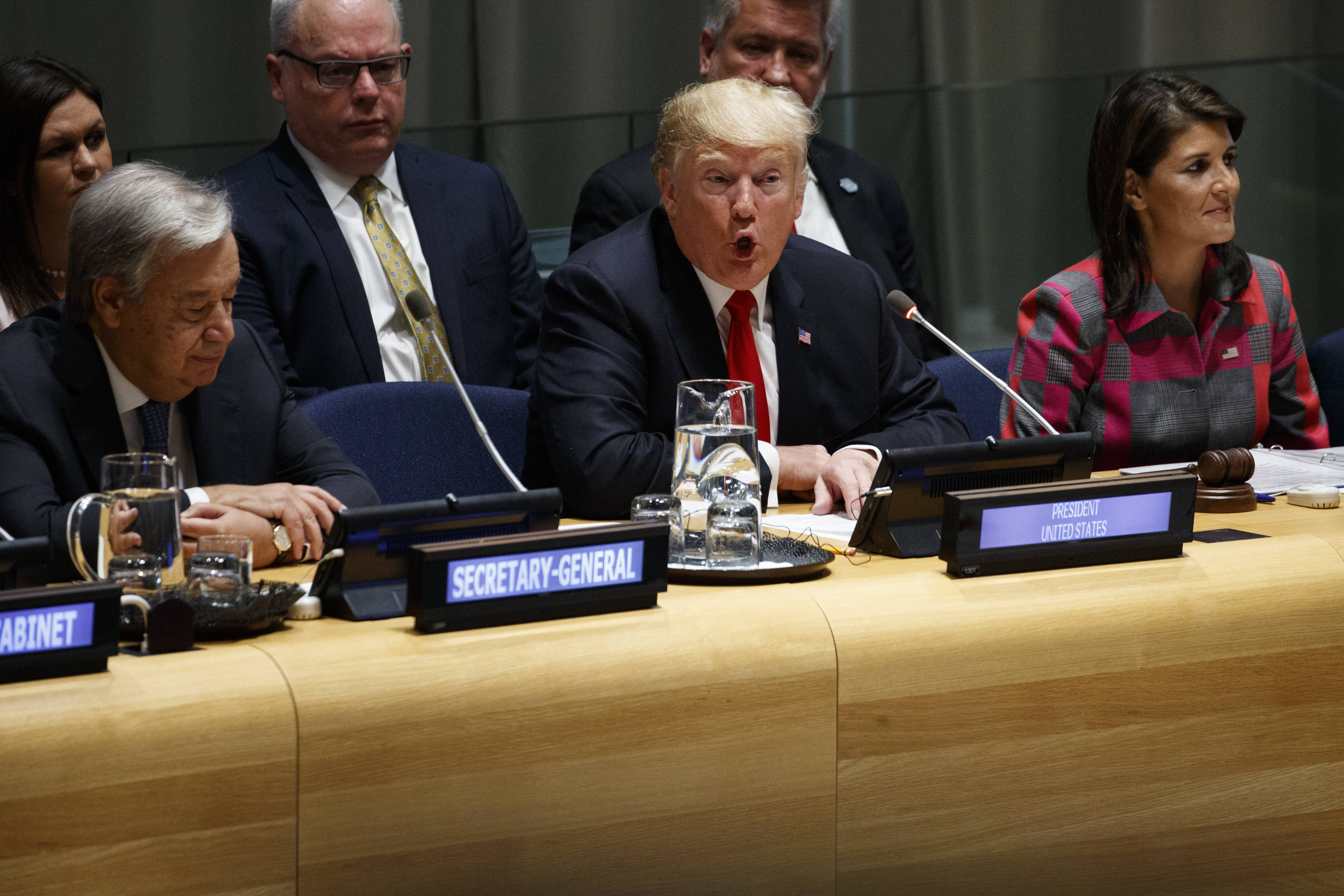 "United Nations Secretary General Antonio Guterres, left, and U.S. Ambassador to the United Nations Nikki Haley, right, listen as President Donald Trump speaks during the ""Global Call to Action on the World Drug Problem"" at the United Nations General Assembly, Monday, Sept. 24, 2018, at U.N. Headquarters."