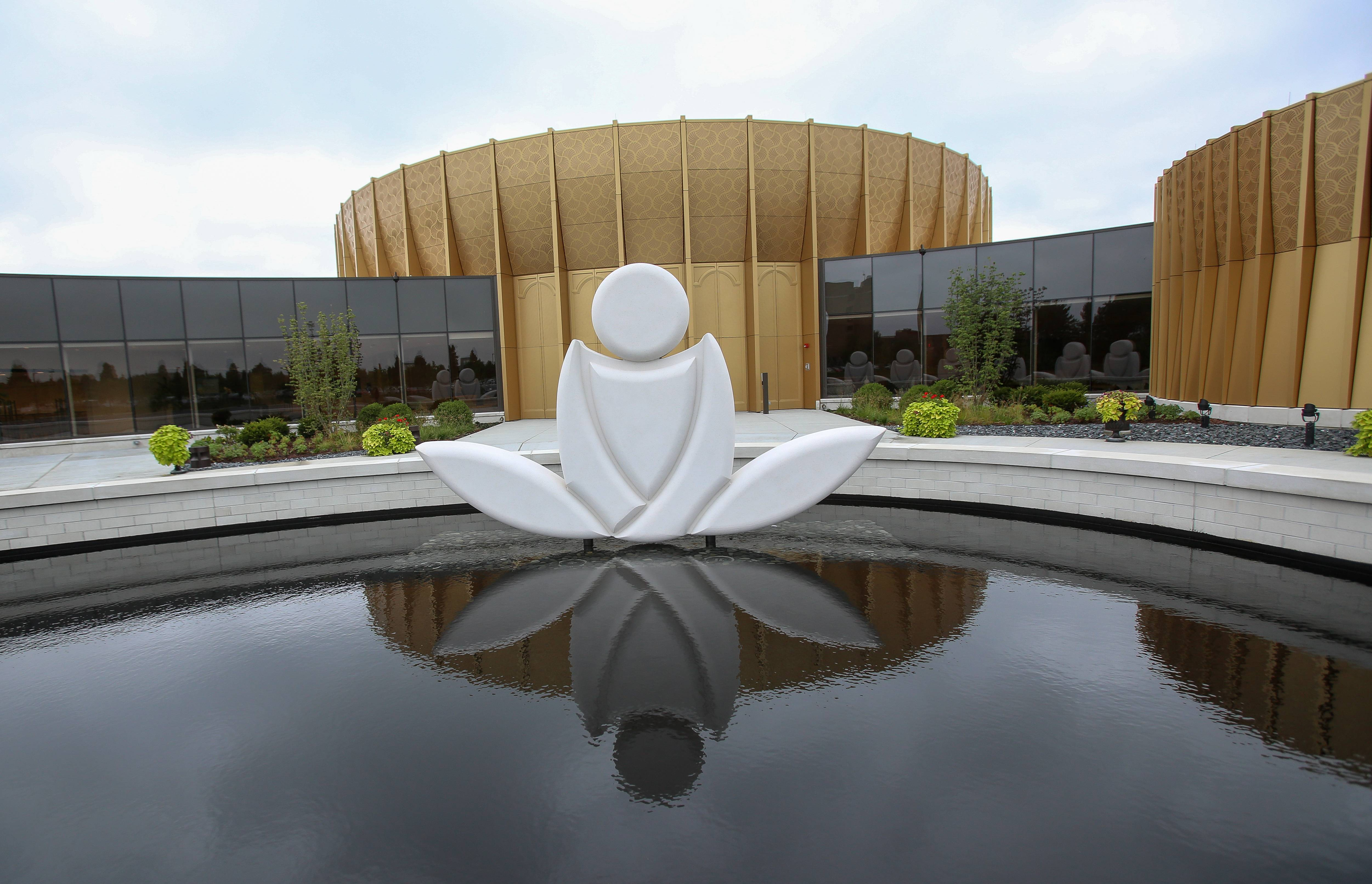 "A reflecting pool and ""meditator"" statue marks the entrance to the new Science of Spirituality International Meditation Center in Lisle."
