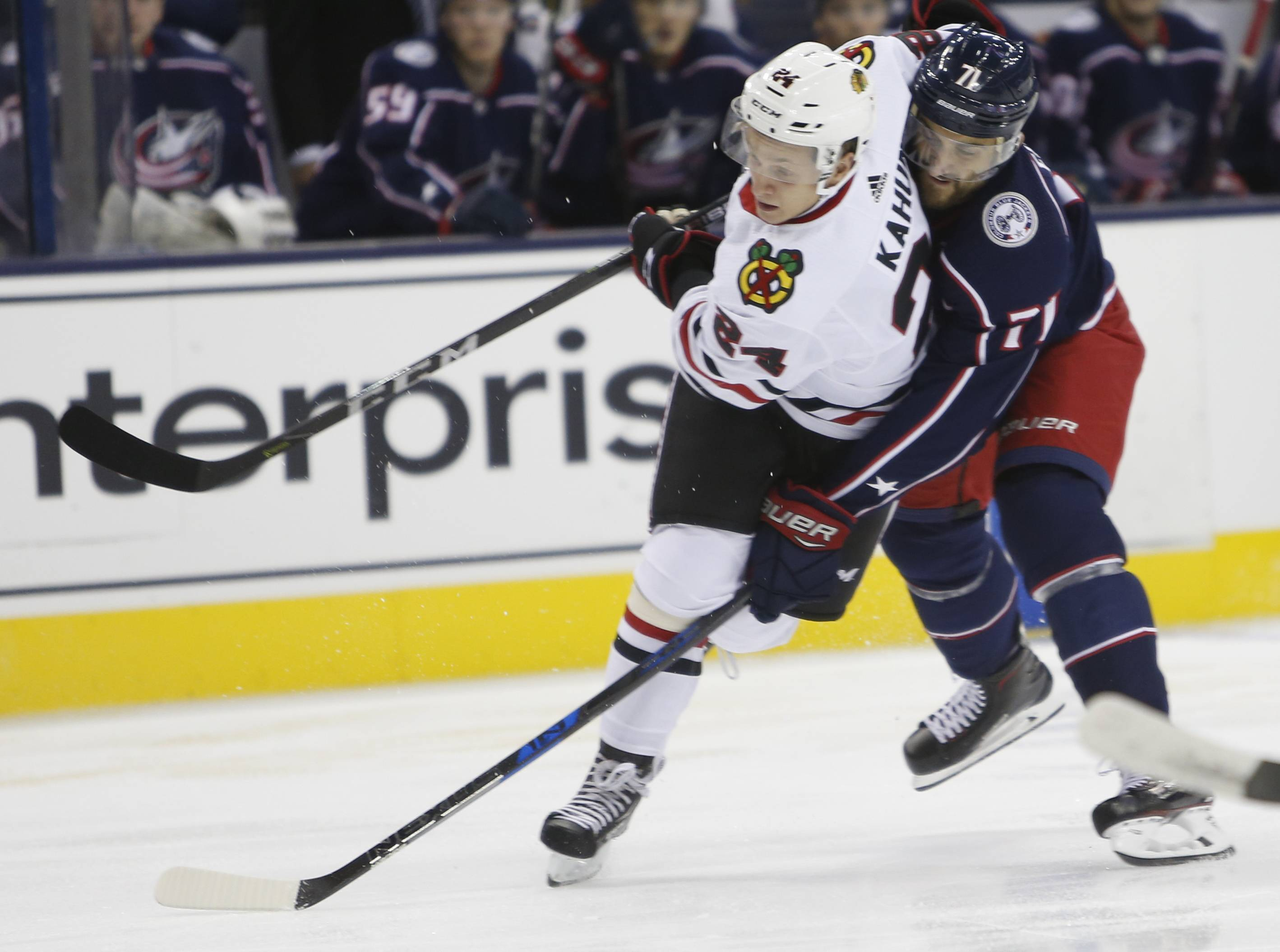 Chicago Blackhawks' Dominik Kahun, left, and Columbus Blue Jackets' Nick Foligno vie for the puck during the first period of a preseason game Tuesday, Sept. 18 in Columbus, Ohio.