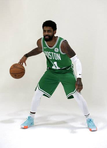Boston Celtics guard Kyrie Irving dribbles the ball during a photo shoot at NBA basketball media day, Monday, Sept. 24, 2018, in Canton, Mass. (AP Photo/Steven Senne)