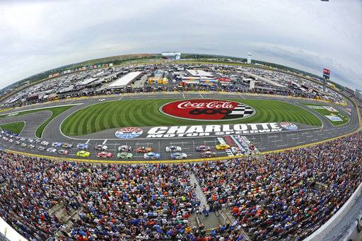 "FIILE - In this May 27, 2018 file photo taken with a fisheye lens, the field takes the green flag to start the NASCAR Cup Series auto race at Charlotte Motor Speedway in Charlotte, N.C. Charlotte Motor Speedway gets a win for the buzz it created by taking a bulldozer to its infield and building something new to NASCAR. Charlotte's ""roval� will debut Sunday, Sept. 30, 2018 in a critical playoff race that debuts a track unlike anything used before in NASCAR. The track isn't an oval or a road course, rather a hybrid venue that combines both Charlotte's existing speedway with a winding course through the infield. (AP Photo/Mike McCarn, file)"