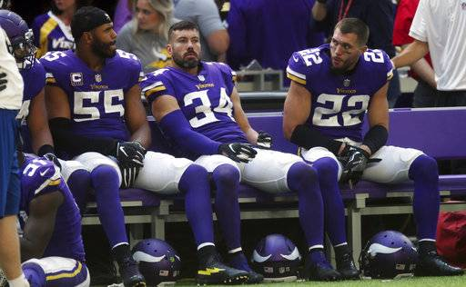 Minnesota Vikings players Anthony Barr, from left, Andrew Sendejo and Harrison Smith sit on the bench aft the end of an NFL football game against the Buffalo Bills, Sunday, Sept. 23, 2018, in Minneapolis. The Bills won 27-6. (AP Photo/Jim Mone)