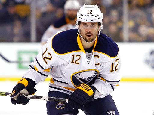 FILE - In this Feb. 6, 2016, file photo, Buffalo Sabres' Brian Gionta is shown during the first period of an NHL hockey game against the Boston Bruins, in Boston. A person with direct knowledge of forward Brian Gionta's decision tells The Associated Press the former Montreal Canadiens and Buffalo Sabres captain, and two-time United States Olympian will announce he's retiring after 16 NHL seasons. The person spoke to The AP on the condition of anonymity Monday, Sept. 24, 2018, because Gionta hasn't publicly revealed what he plans to announce during a news conference scheduled for later in the day at the Sabres downtown arena. (AP Photo/Winslow Townson, File)