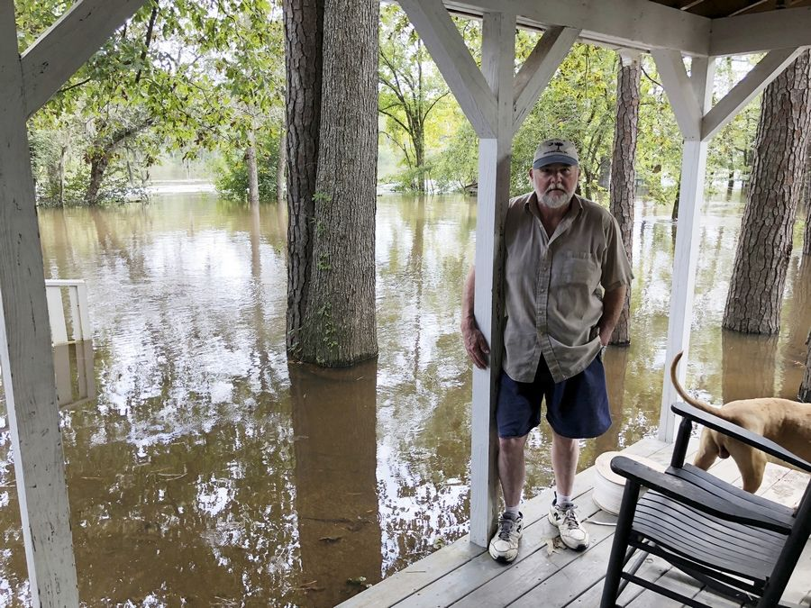 Pastor Willie Lowrimore of The Fellowship With Jesus Ministries talks about the flooding of his church in Yauhannah, S.C., on Monday, Sept. 24, 2018. The church is on the bank of the Waccamaw River which has already risen above its record crest and is expected to keep rising for several days, forcing thousands of evacuations in the aftermath of Hurricane Florence.