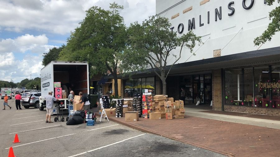 Employees at Tomlinson Department Store take all the merchandise out of the store in Georgetown, South Carolina, on Monday, Sept. 24, 2018. Officials have been warning of record flooding in the area from Hurricane Florence for days. (Associated Press/Jeffrey Collins)