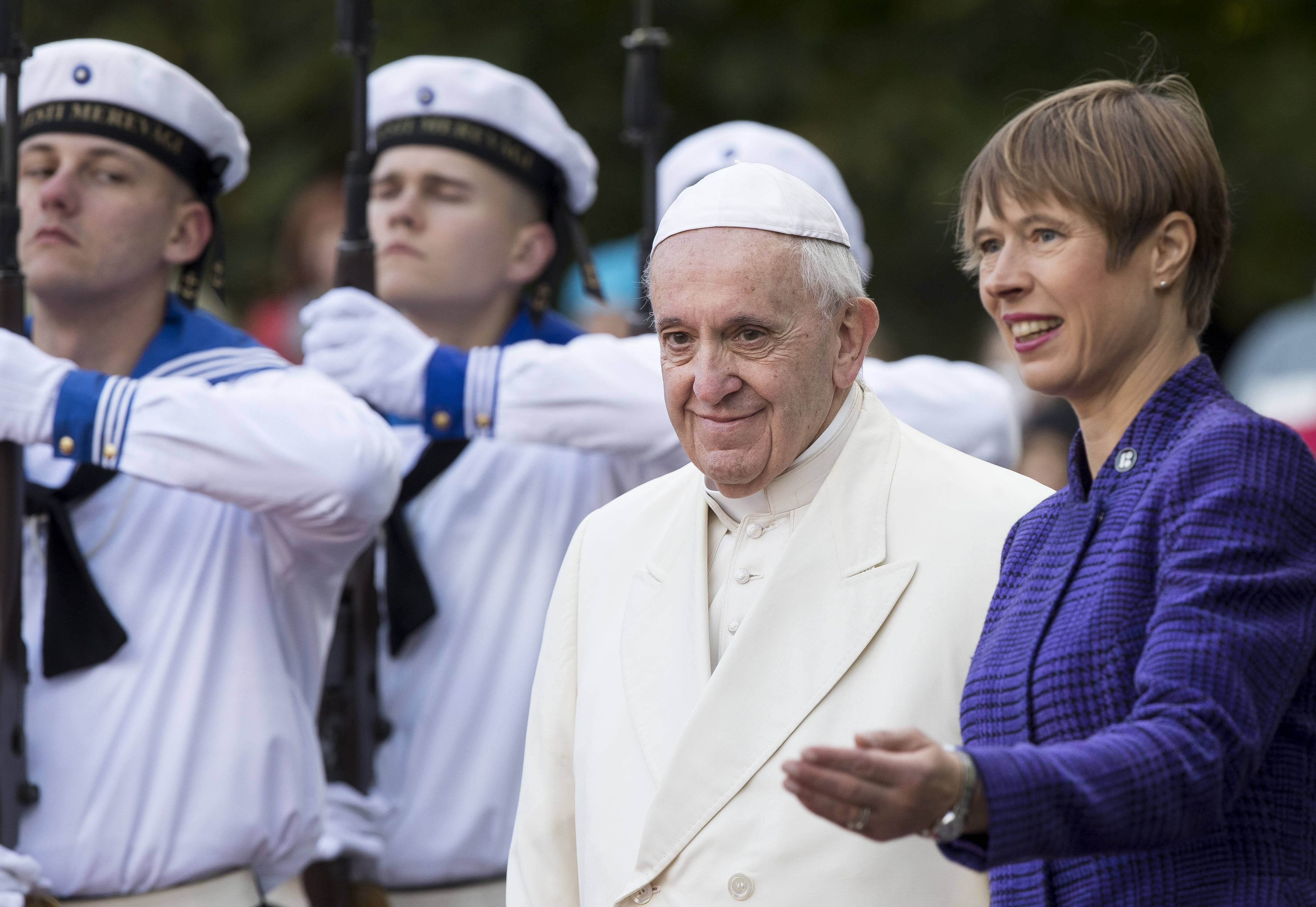 President of Estonia Kersti Kaljulaid, right, welcomes Pope Francis as he arrives at the Kadriorg Presidential Palace in Tallinn, Estonia, Tuesday, Sept. 25, 2018. Pope Francis concludes his four-day tour of the Baltics visiting Estonia.
