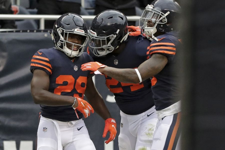 9b4b6e3d748 Chicago Bears running back Tarik Cohen (29) celebrates a touchdown with  teammates during the
