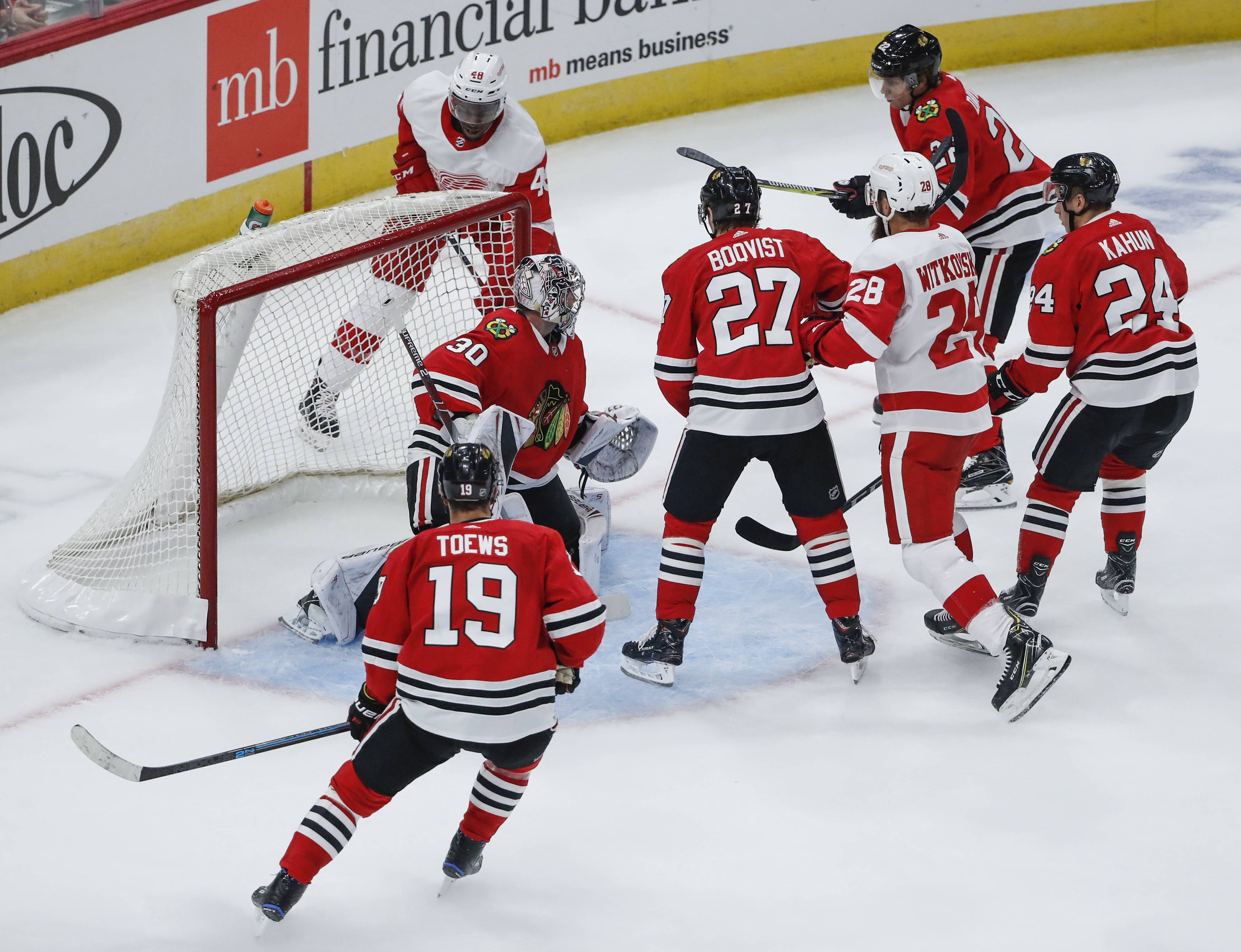 Detroit Red Wings forward Givani Smith (48) scores against Chicago Blackhawks goaltender Cam Ward (30) during the second period of an NHL hockey preseason game Tuesday, Sept. 25, 2018, in Chicago. (AP Photo/Kamil Krzaczynski)
